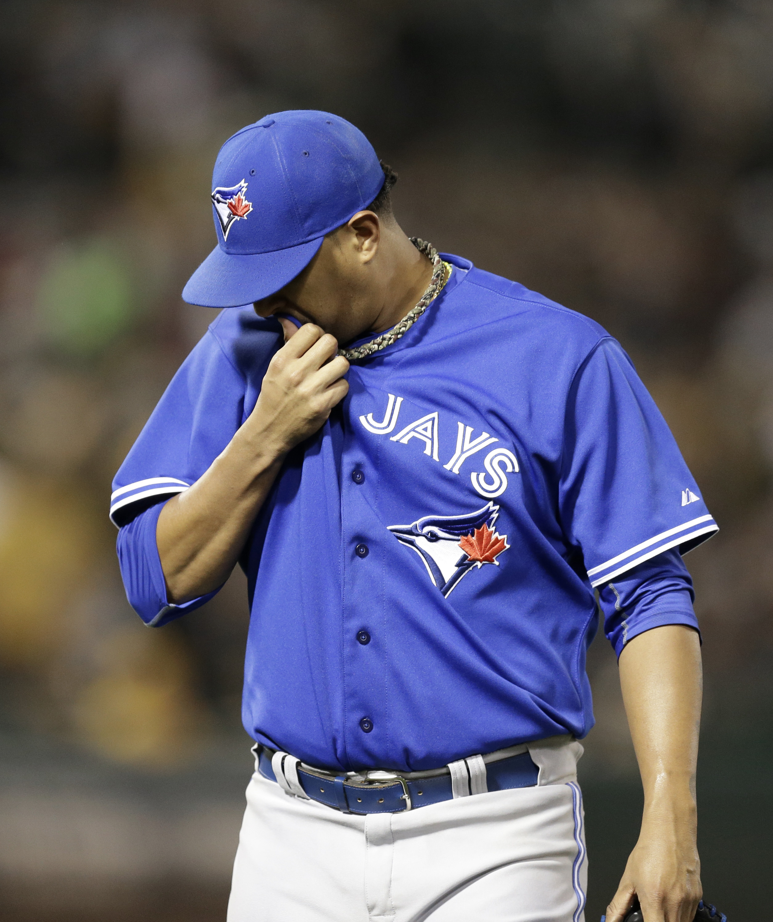 Toronto Blue Jays pitcher Felix Doubront wipes his face on his jersey as he is removed during the fifth inning of a baseball game against the Oakland Athletics on Wednesday, July 22, 2015, in Oakland, Calif. (AP Photo/Ben Margot)