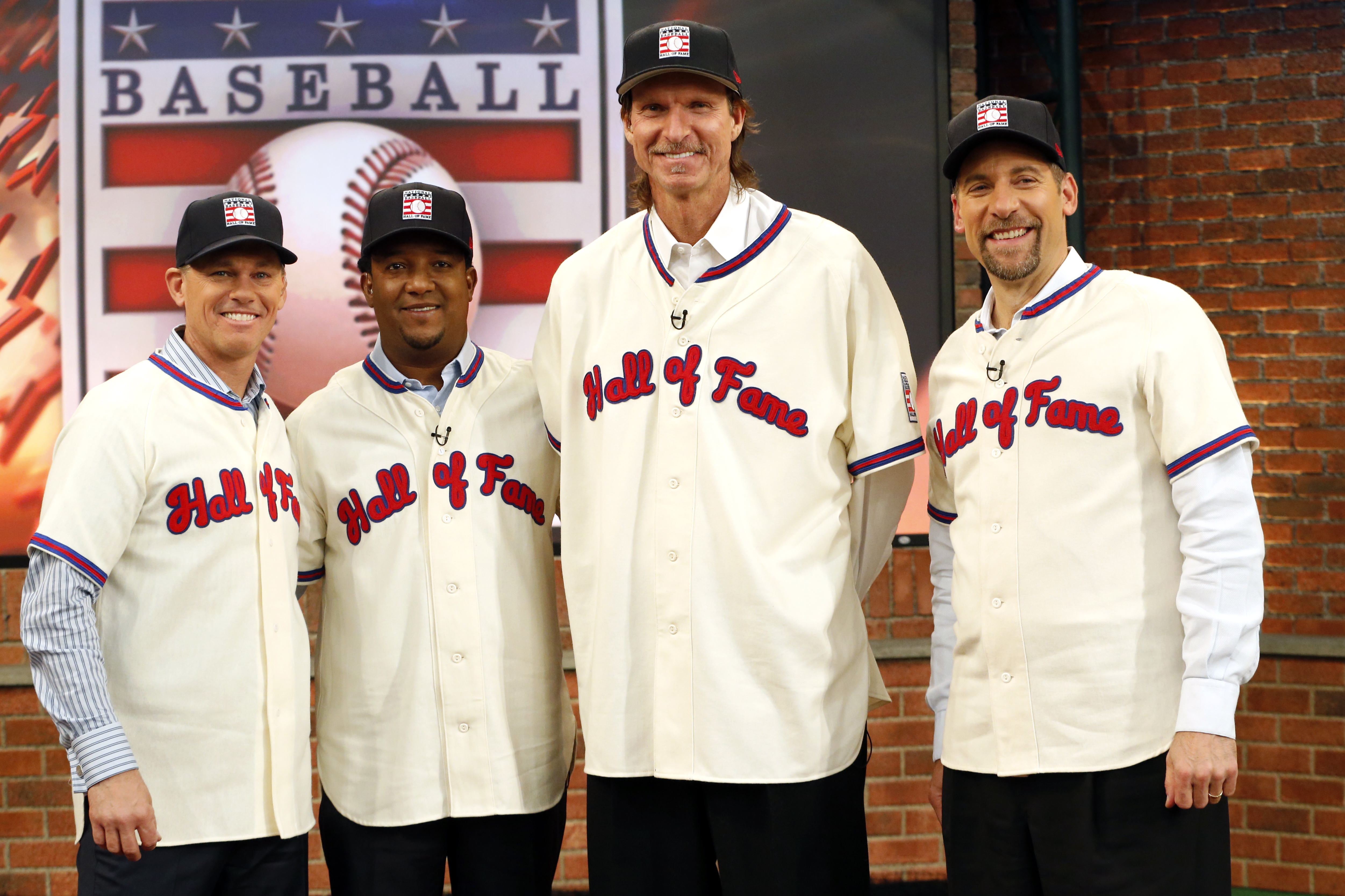 ADVANCE FOR WEEKEND EDITIONS, JUNE 24-26 - FILE - In this Jan. 7, 2015, file photo, members of the National Baseball Hall of Fame 2015 inductee class, from left, Craig Biggio, Pedro Martinez, Randy Johnson and John Smoltz pose for photographers at the MLB