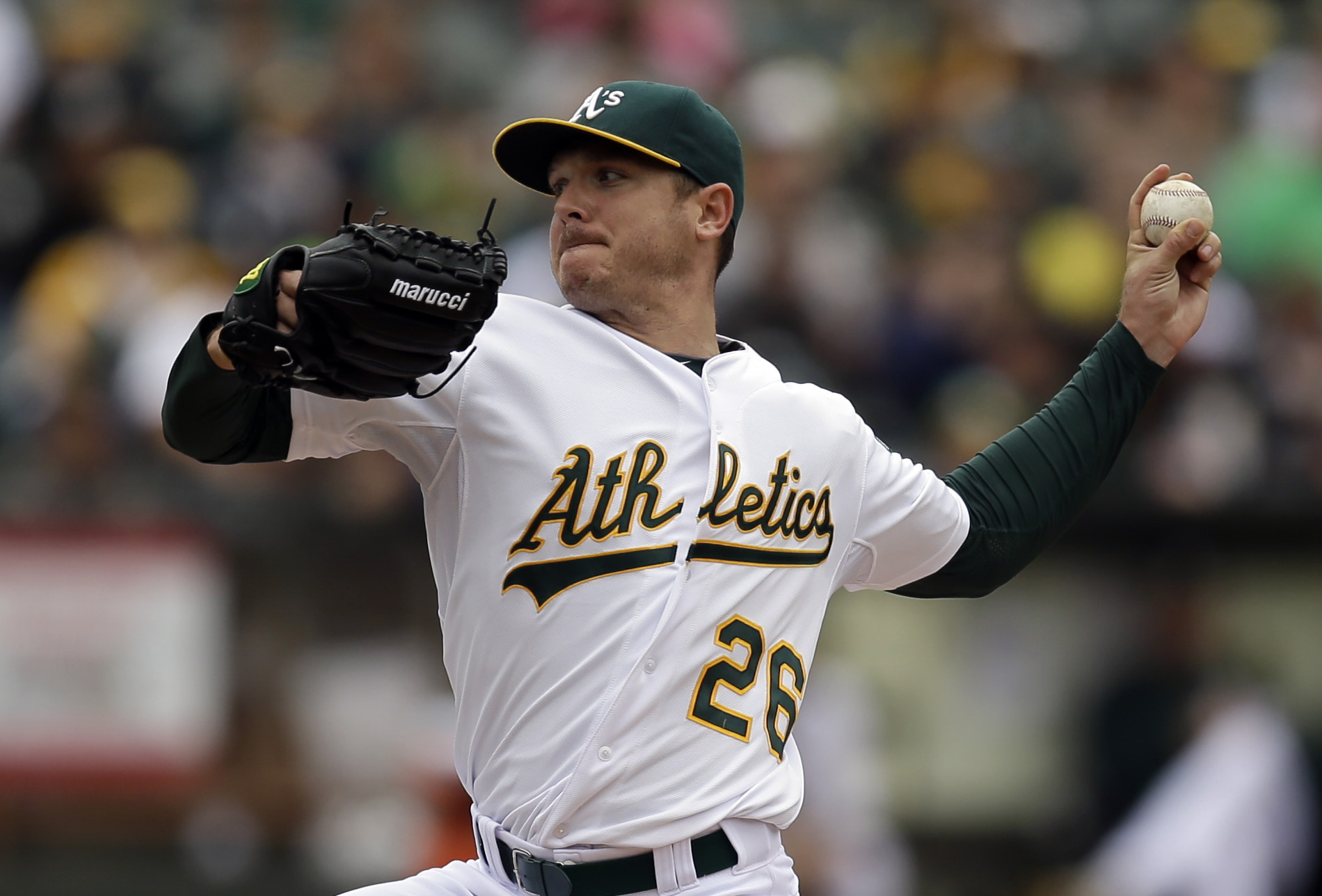 FILE - In this May 17, 2015, file photo, Oakland Athletics pitcher Scott Kazmir works against the Chicago White Sox in the first inning of a baseball game, in Oakland, Calif. The Athletics have begun their expected changes leading up to the trade deadline