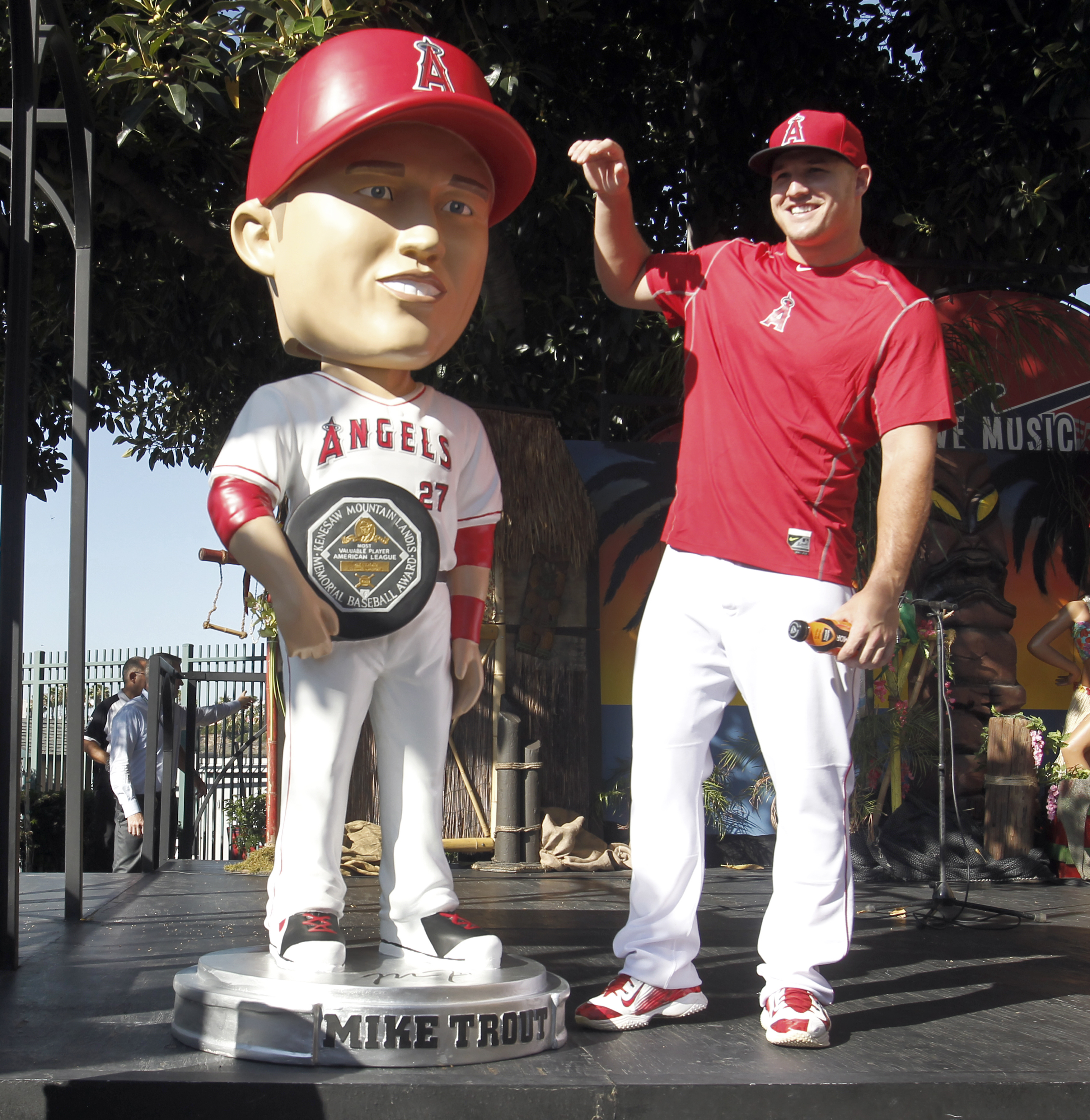 Los Angeles Angels' Mike Trout reacts after unveiling an life-sized bobblehead doll before a baseball game against the Texas Rangers in Anaheim, Calif., Friday, July 24, 2015. (AP Photo/Alex Gallardo)