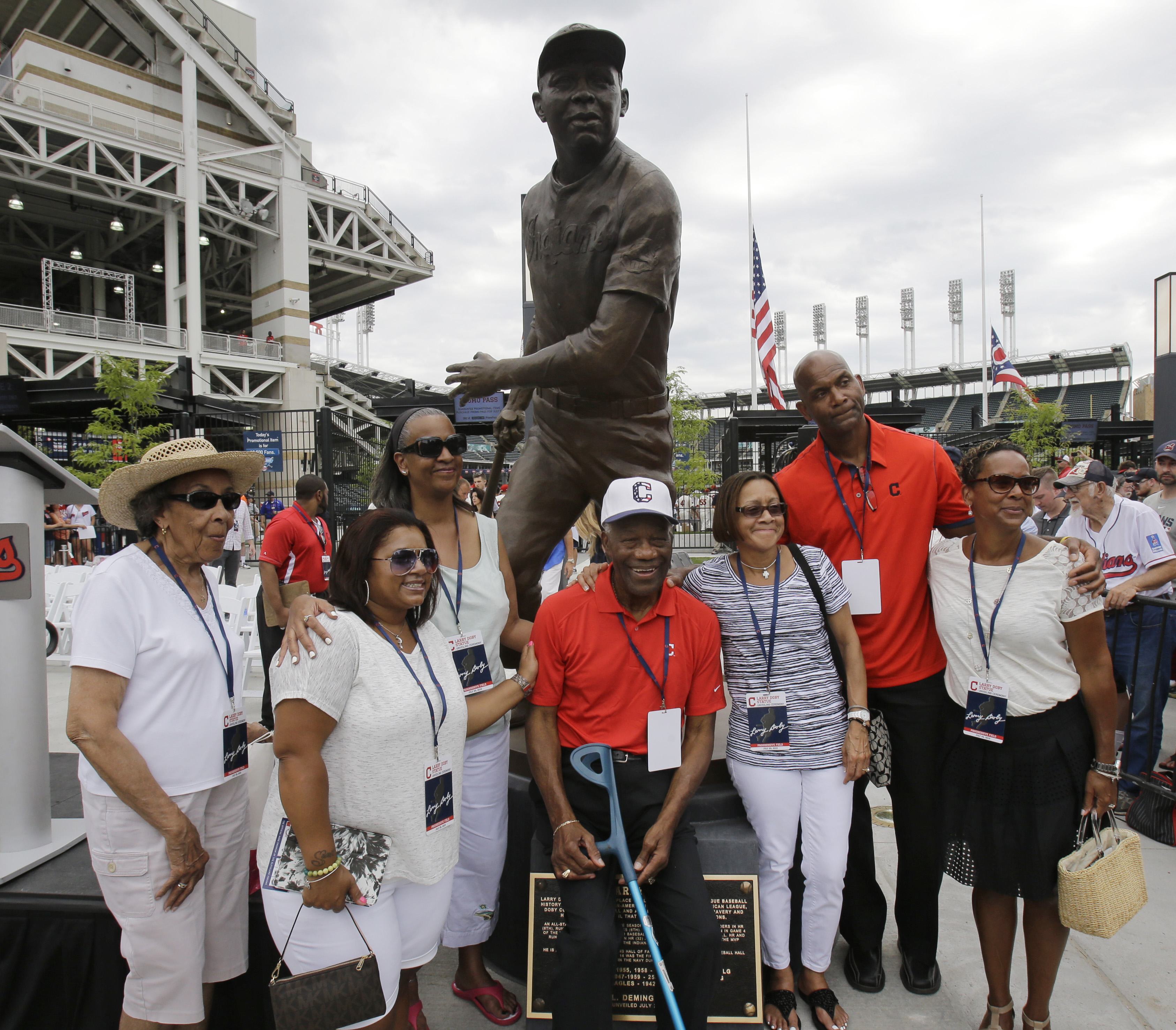"""Larry Doby Jr., second from right, along with his family and James Timothy """"Mudcat"""" Grant, center, a former Major League Baseball pitcher are shown after the unveiling of a statue of Hall of Fame Larry Doby Saturday, July 25, 2015, in Cleveland. Doby brok"""