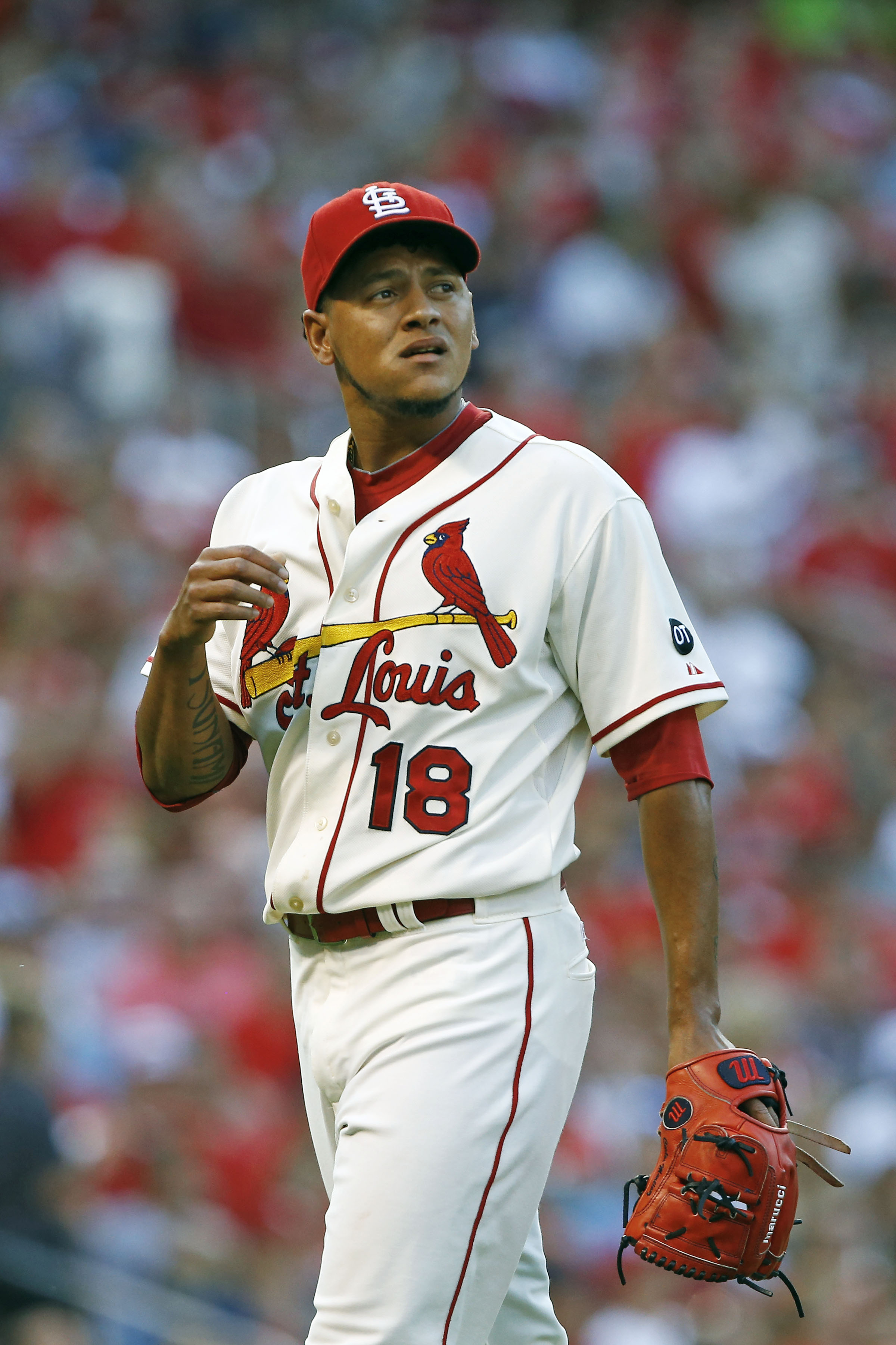 St. Louis Cardinals starting pitcher Carlos Martinez walks off the field after striking out Atlanta Braves' Shelby Miller to get out of a bases loaded jam during the second inning of a baseball game Saturday, July 25, 2015, in St. Louis. (AP Photo/Billy H