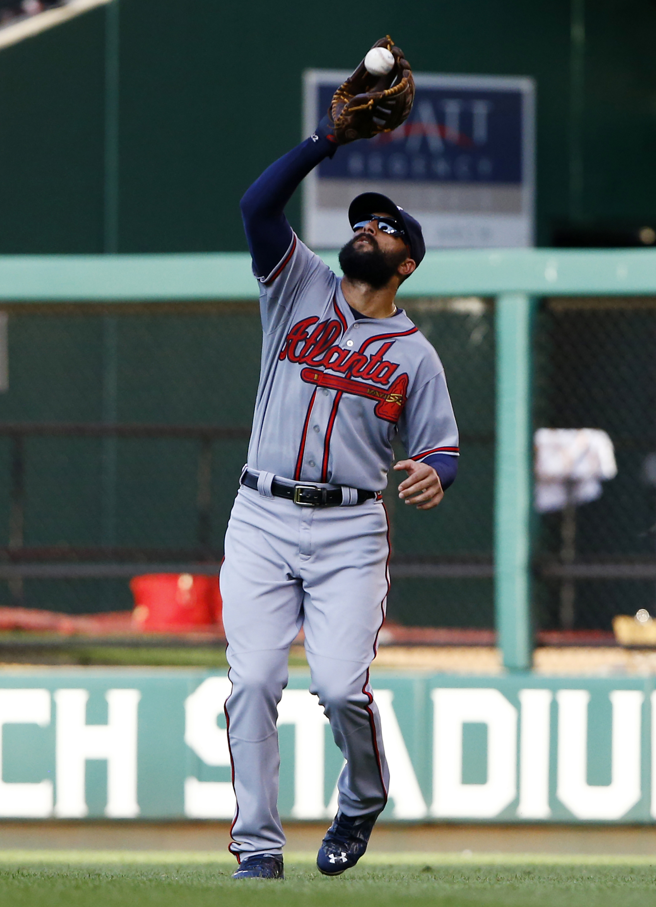 Atlanta Braves right fielder Nick Markakis catches a fly ball hit by St. Louis Cardinals' Jhonny Peralta during the fourth inning of a baseball game Saturday, July 25, 2015, in St. Louis. (AP Photo/Billy Hurst)