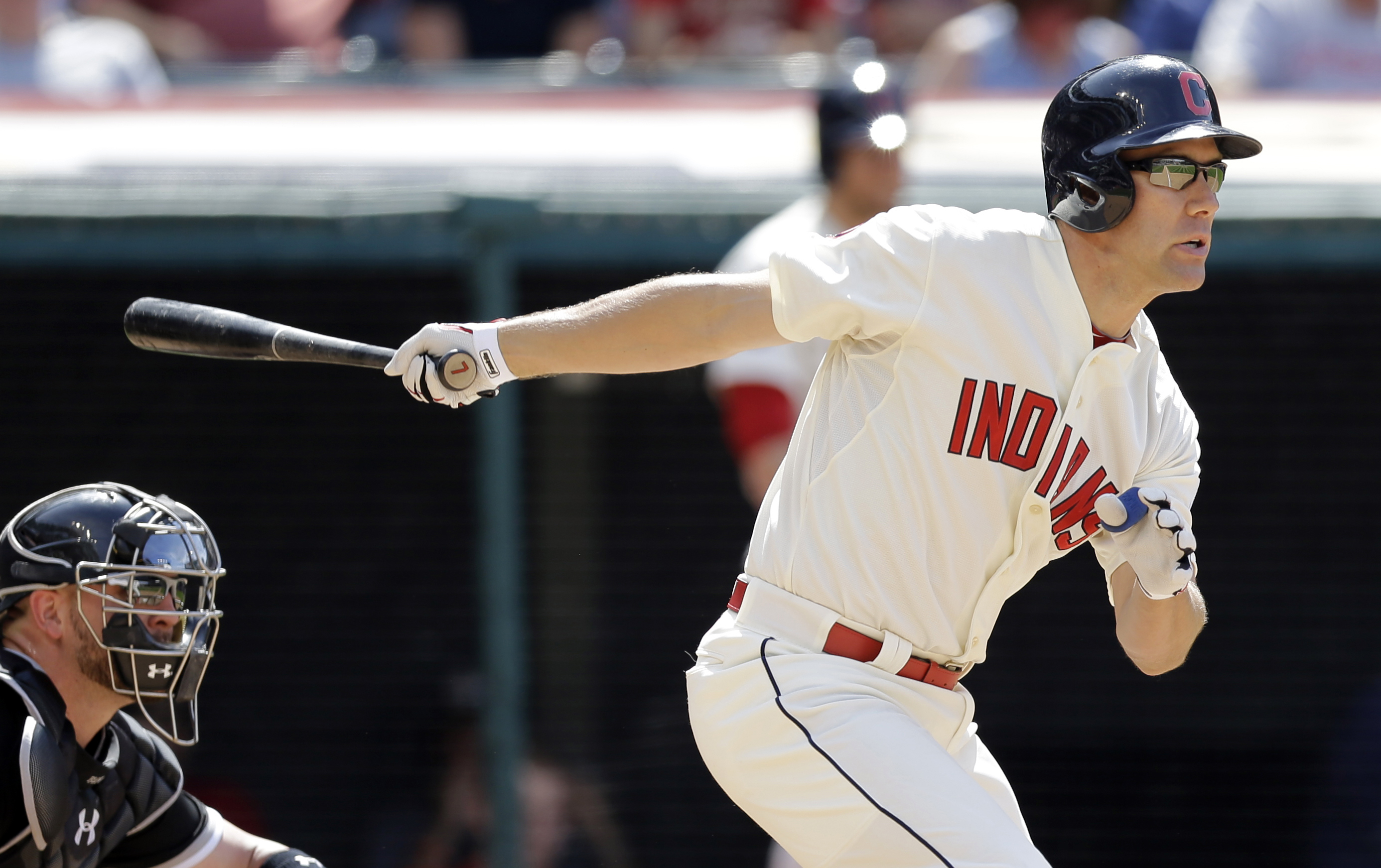 Cleveland Indians' David Murphy, right, grounds out in the ninth inning of a baseball game against the Chicago White Sox, Sunday, July 26, 2015, in Cleveland. Giovanny Urshela scored on the play. White Sox catcher Tyler Flowers looks on. The White Sox won