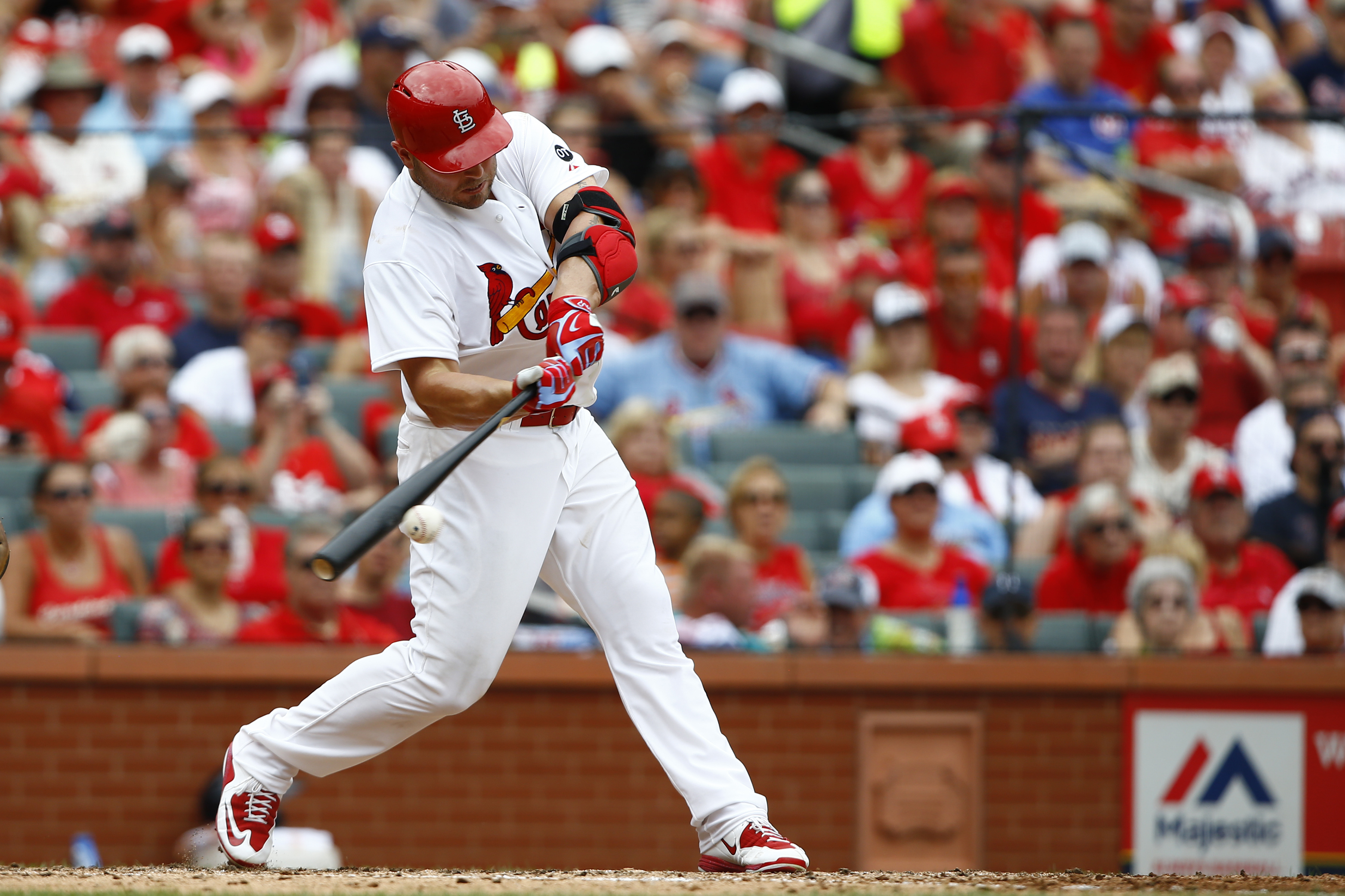 St. Louis Cardinals' Matt Holliday hits an RBI double during the sixth inning of a baseball game against the Atlanta Braves, Sunday, July 26, 2015, in St. Louis. (AP Photo/Billy Hurst)