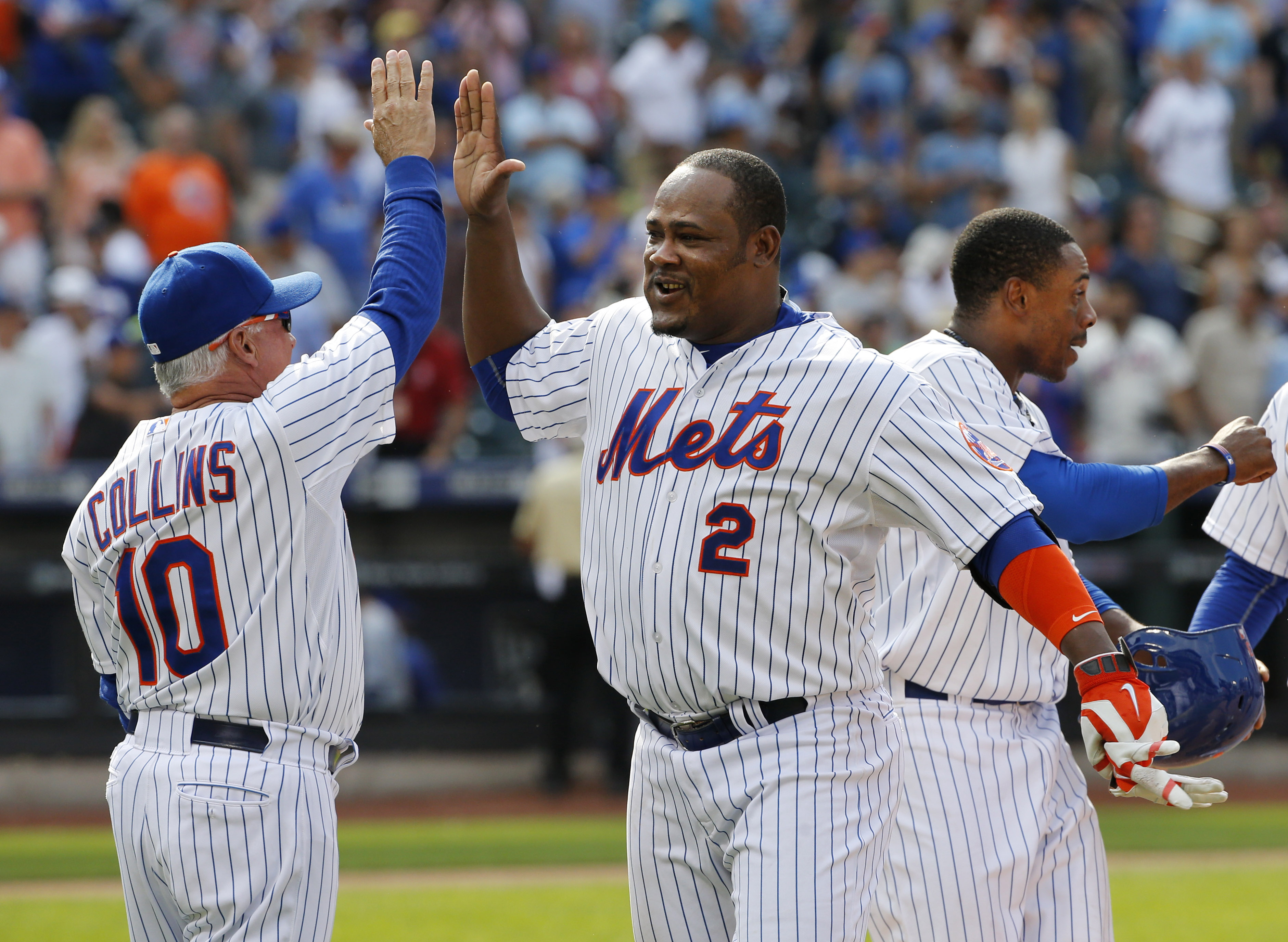 New York Mets manager Terry Collins (10) and the Mets Juan Uribe (2), who joined the team Saturday after a trade, celebrate after Uribe hit a tenth-inning, walk-off single to lift the Mets to a 3-2 victory over the Los Angeles Dodgers in a baseball game i