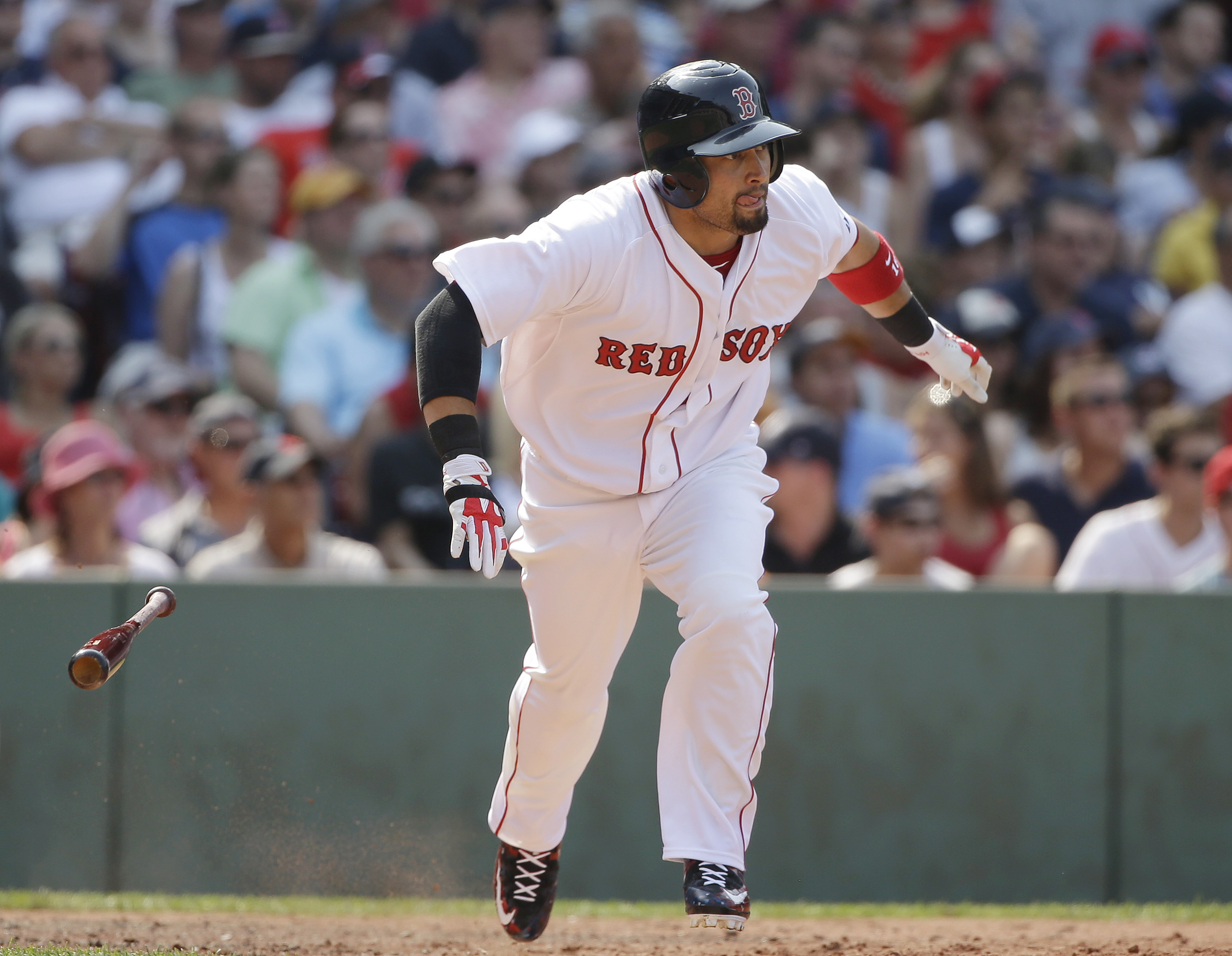 Boston Red Sox's Shane Victorino singles in the sixth inning of a baseball game against the New York Yankees at Fenway Park, Sunday, July 12, 2015, in Boston. (AP Photo/Steven Senne)