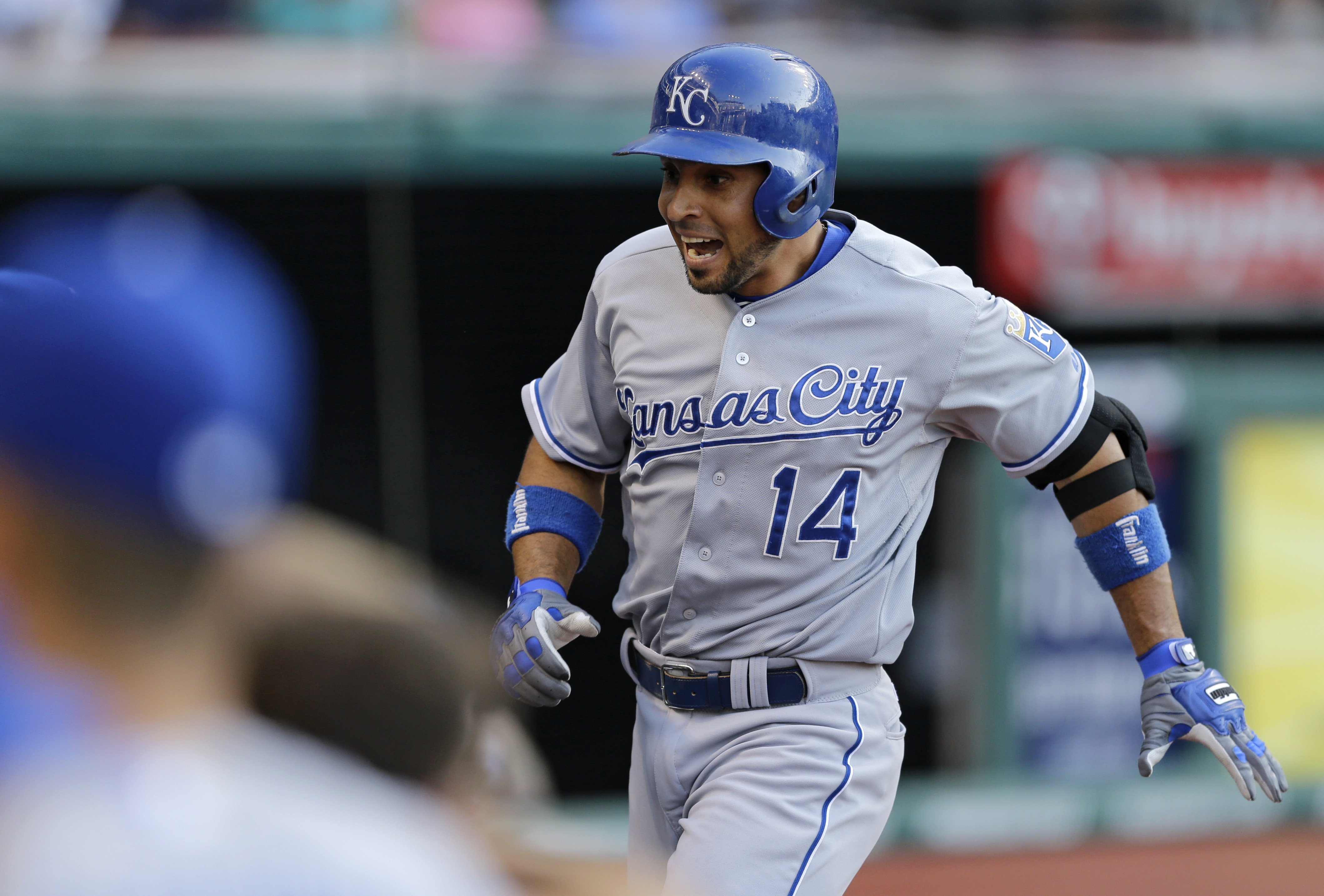 Kansas City Royals' Omar Infante gets ready to jump into the dugout after hitting a solo home run off Cleveland Indians starting pitcher Cody Anderson in the second inning of a baseball game, Monday, July 27, 2015, in Cleveland. (AP Photo/Tony Dejak)