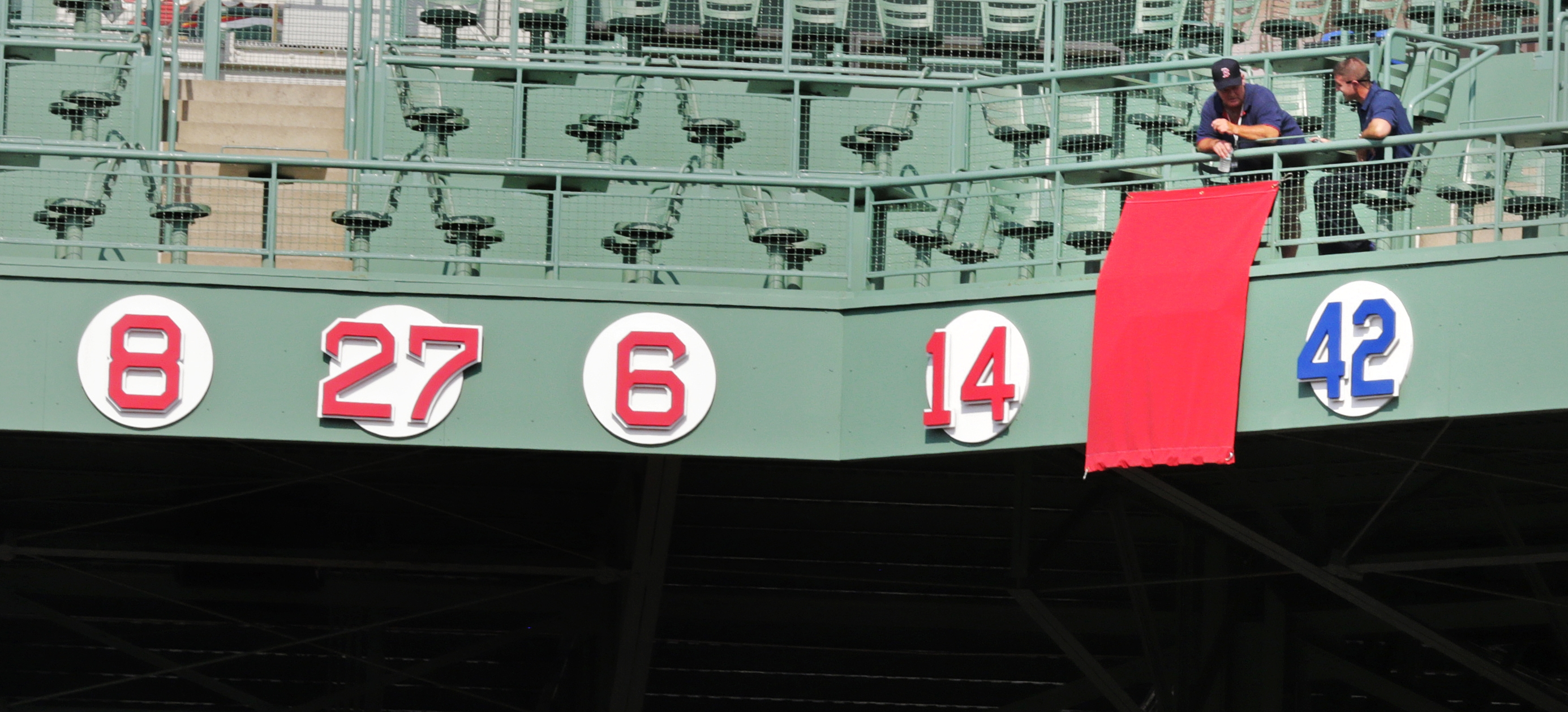 A drape covers the number 45 of Boston Red Sox Hall of Fame pitcher Pedro Martinez prior to a baseball game against the Chicago White Sox at Fenway Park in Boston, Tuesday, July 28, 2015. Martinez's jersey number will be retired, and hang between Red Sox'