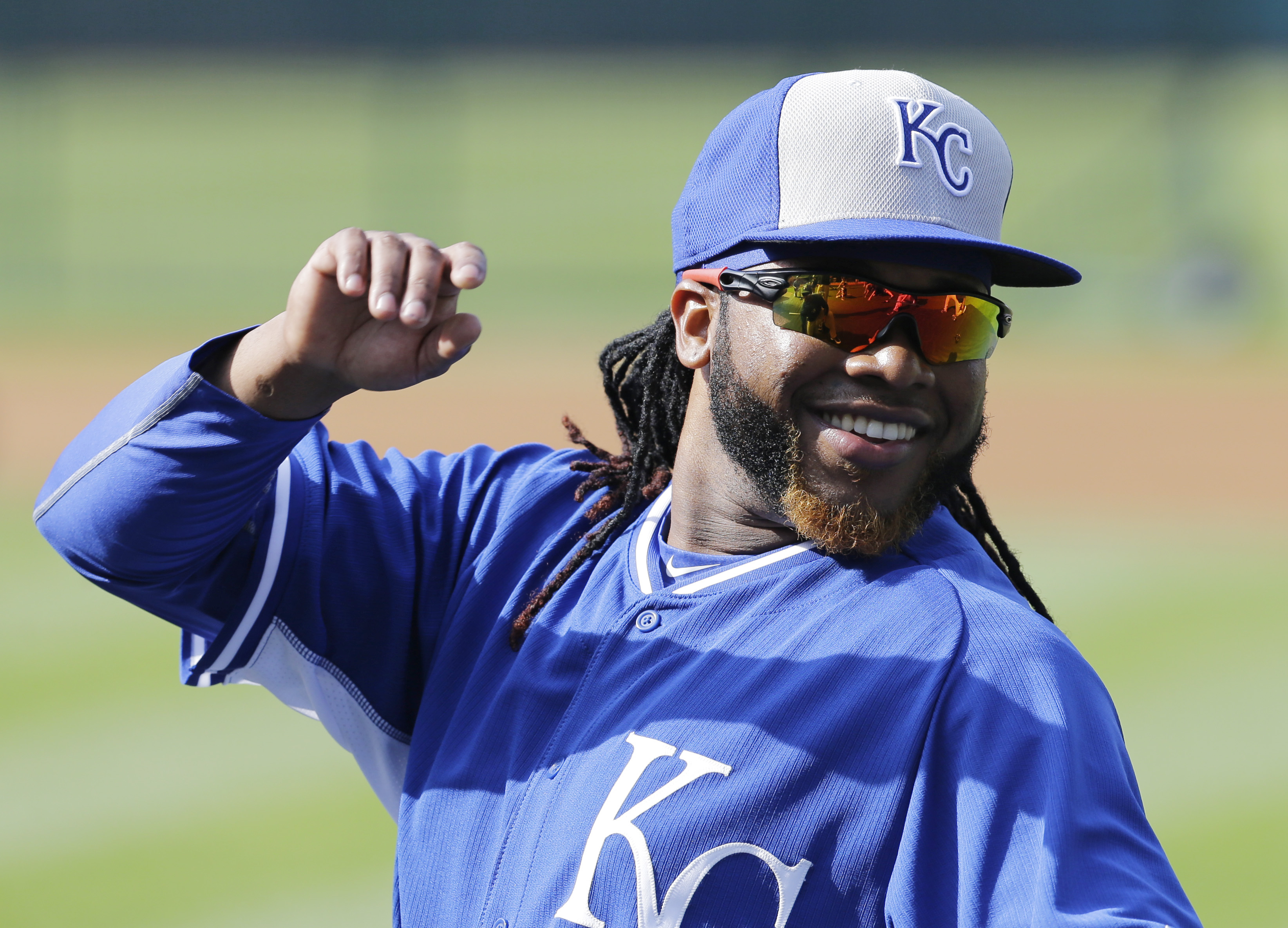 Kansas City Royals' Johnny Cueto stretches and smiles before the Royals play the Cleveland Indians in a baseball game, Tuesday, July 28, 2015, in Cleveland. (AP Photo/Tony Dejak)