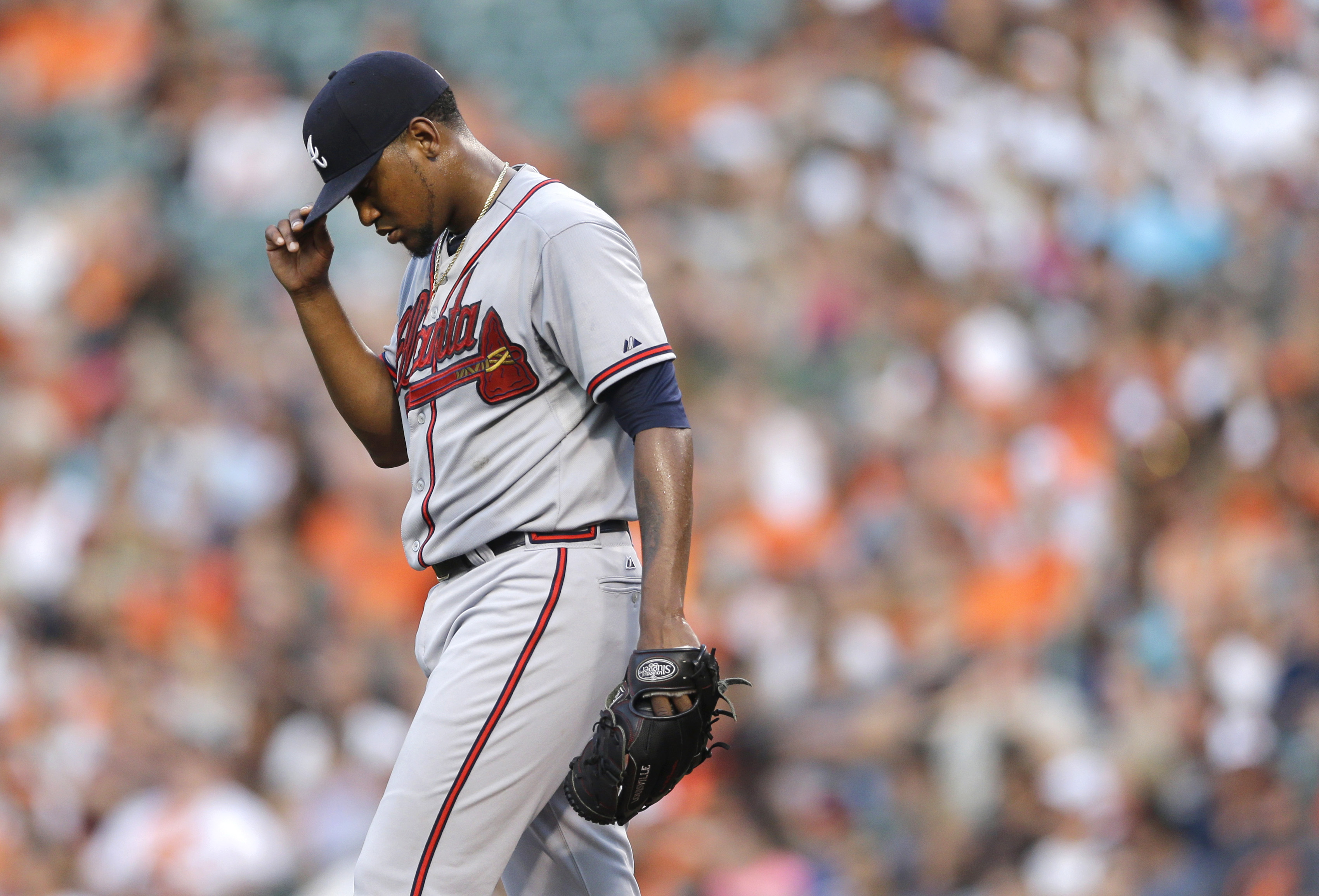 Atlanta Braves starting pitcher Julio Teheran adjusts his cap after walking Baltimore Orioles' Chris Parmelee in the first inning of an interleague baseball game, Tuesday, July 28, 2015, in Baltimore. Teheran gave up three runs in the first. (AP Photo/Pat