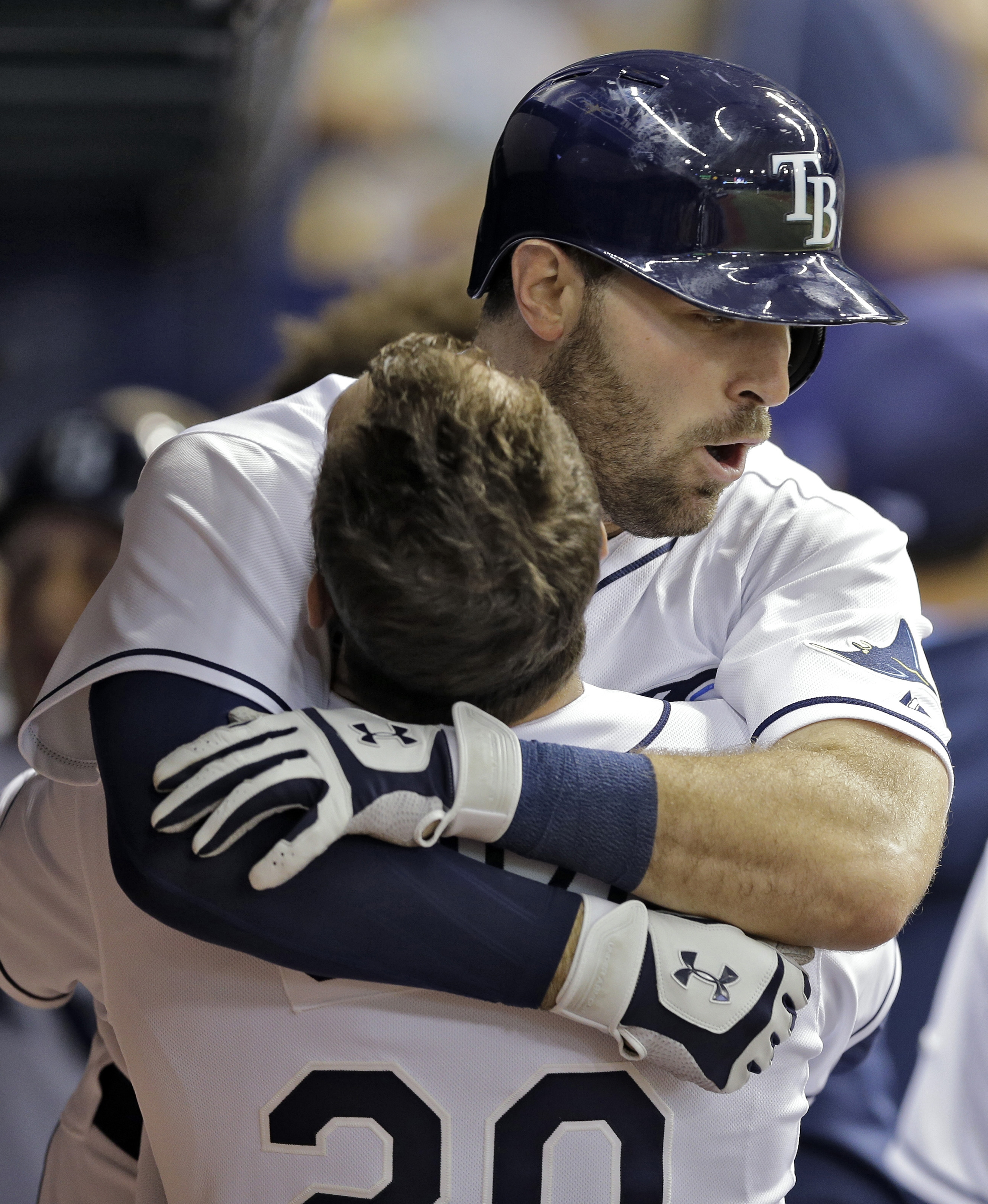 Tampa Bay Rays' Curt Casali, right, hugs Steven Souza Jr. in the dugout after Casili hit a two-run home run off Detroit Tigers starting pitcher David Price during the fourth inning of a baseball game Tuesday, July 28, 2015, in St. Petersburg, Fla.  Rays'