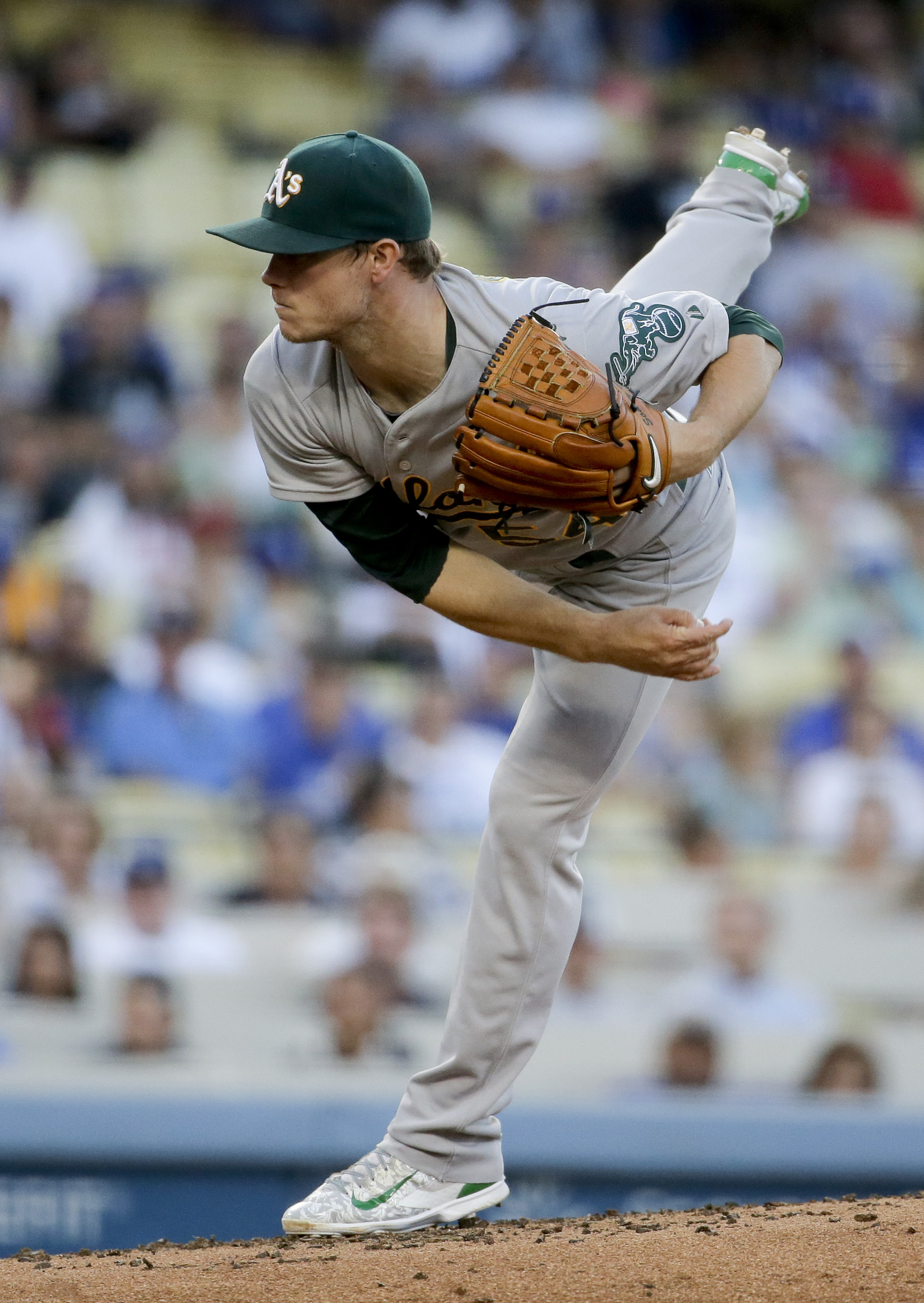 Oakland Athletics starting pitcher Sonny Gray throws against the Los Angeles Dodgers during the first inning of a baseball game in Los Angeles, Tuesday, July 28, 2015. (AP Photo/Chris Carlson)