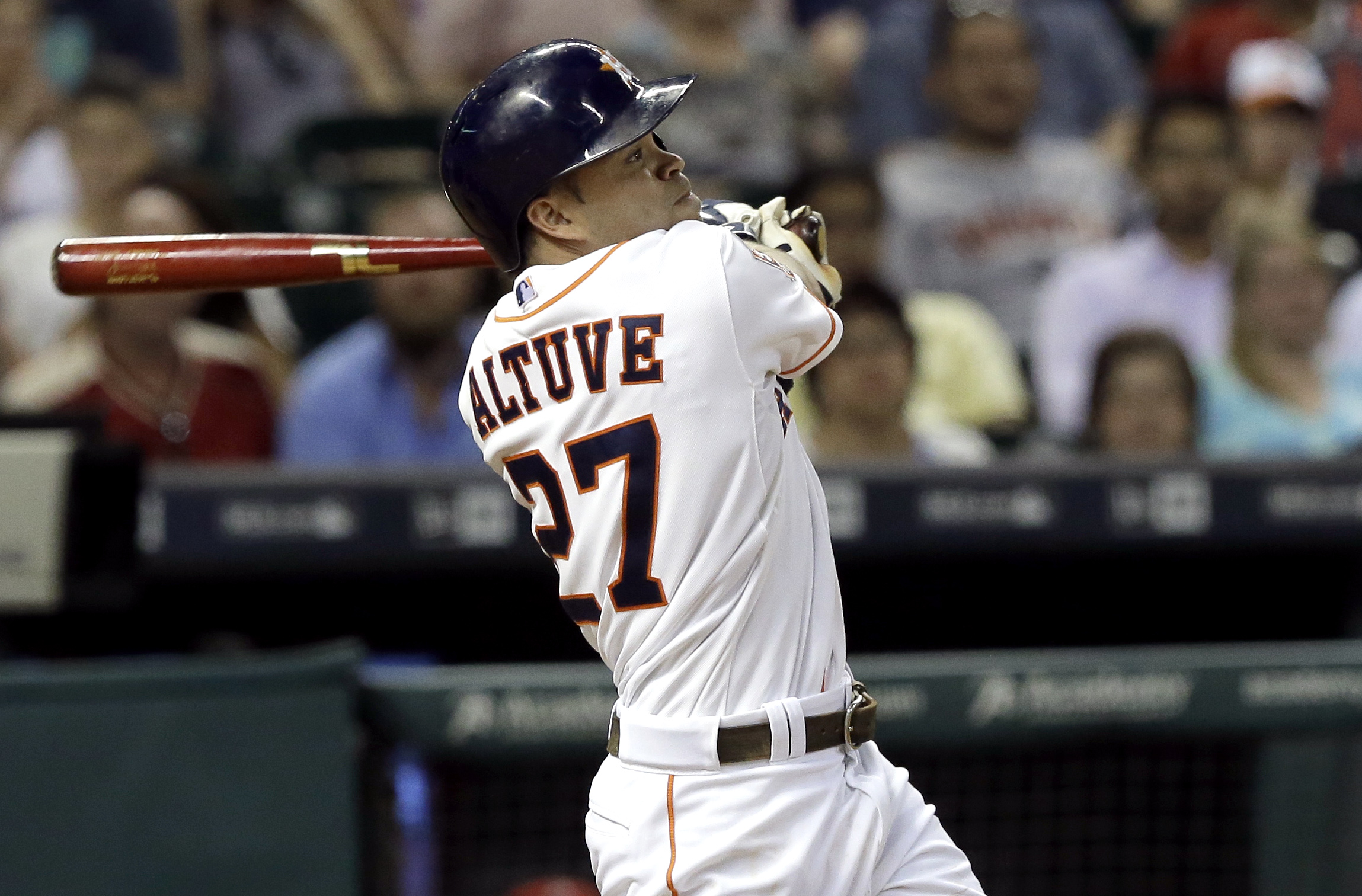 Houston Astros' Jose Altuve watches the ball go long to left field for a two-run double against the Los Angeles Angels in the sixth inning of a baseball game Tuesday, July 28, 2015, in Houston. (AP Photo/Pat Sullivan)