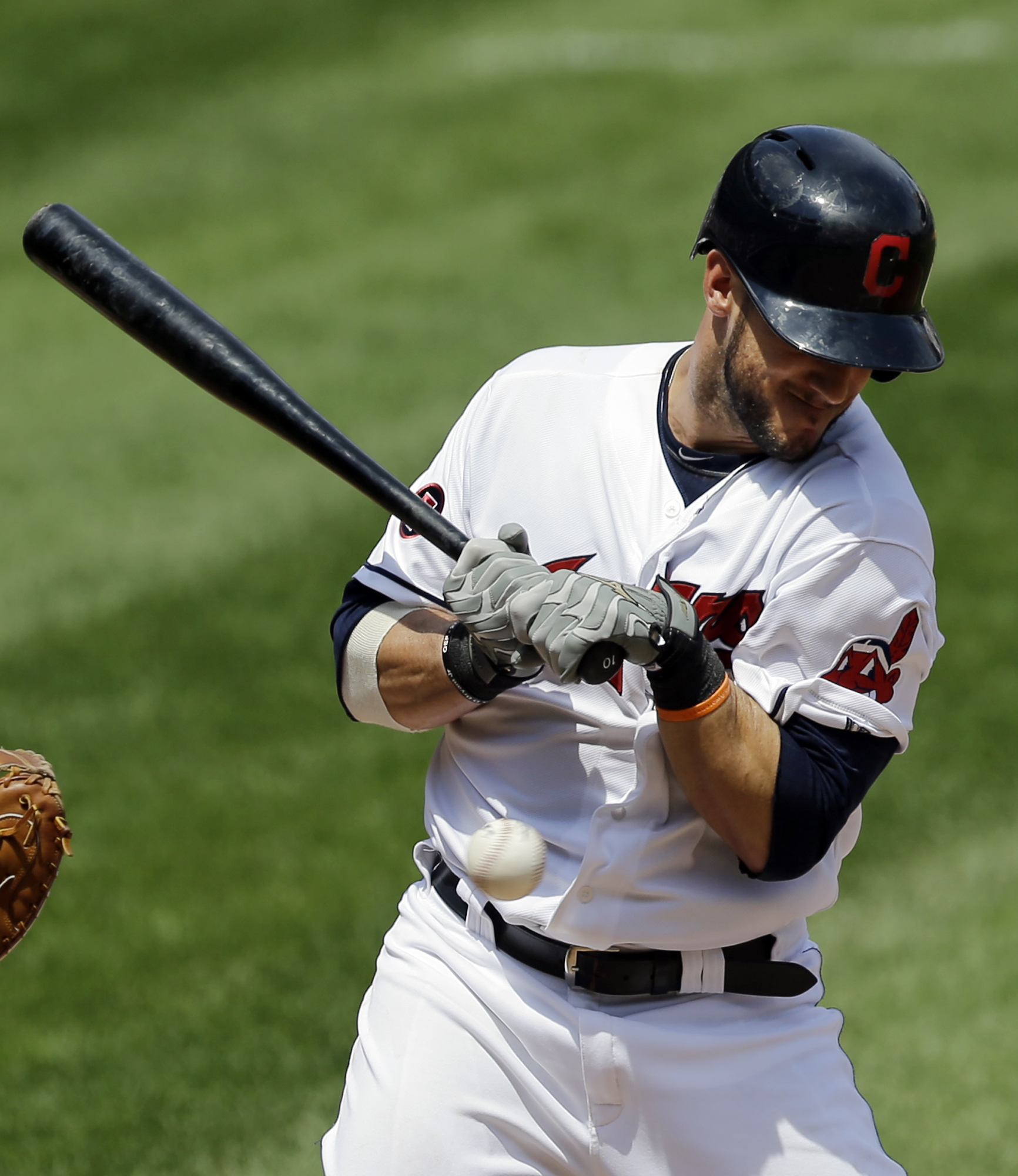 Cleveland Indians' Yan Gomes is hit by a pitch from Kansas City Royals starting pitcher Jeremy Guthrie in the first inning of a baseball game, Wednesday, July 29, 2015, in Cleveland. Jason Kipnis scored on the play. (AP Photo/Tony Dejak)
