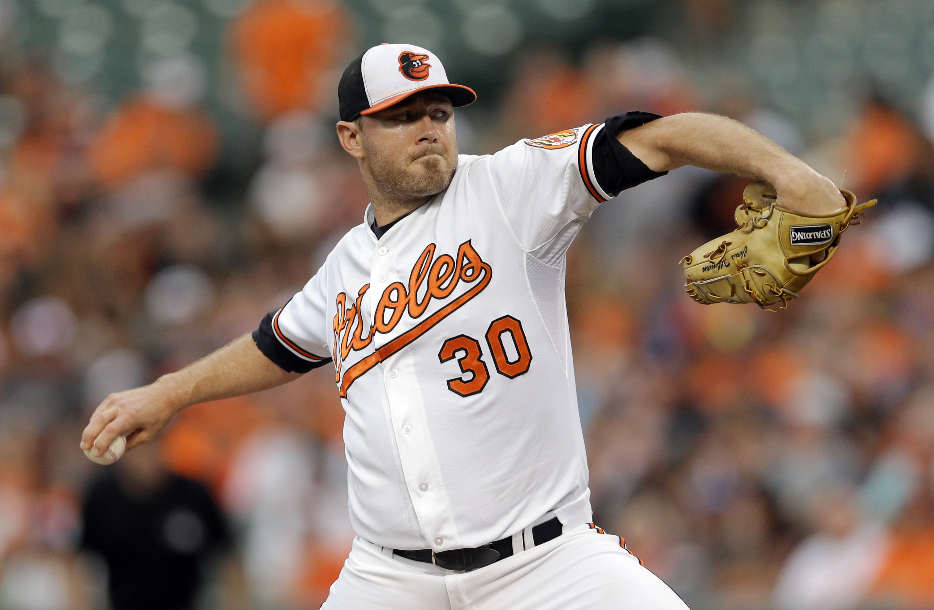 Baltimore Orioles starting pitcher Chris Tillman throws to the Atlanta Braves in the first inning of an interleague baseball game, Wednesday, July 29, 2015, in Baltimore. (AP Photo/Patrick Semansky)