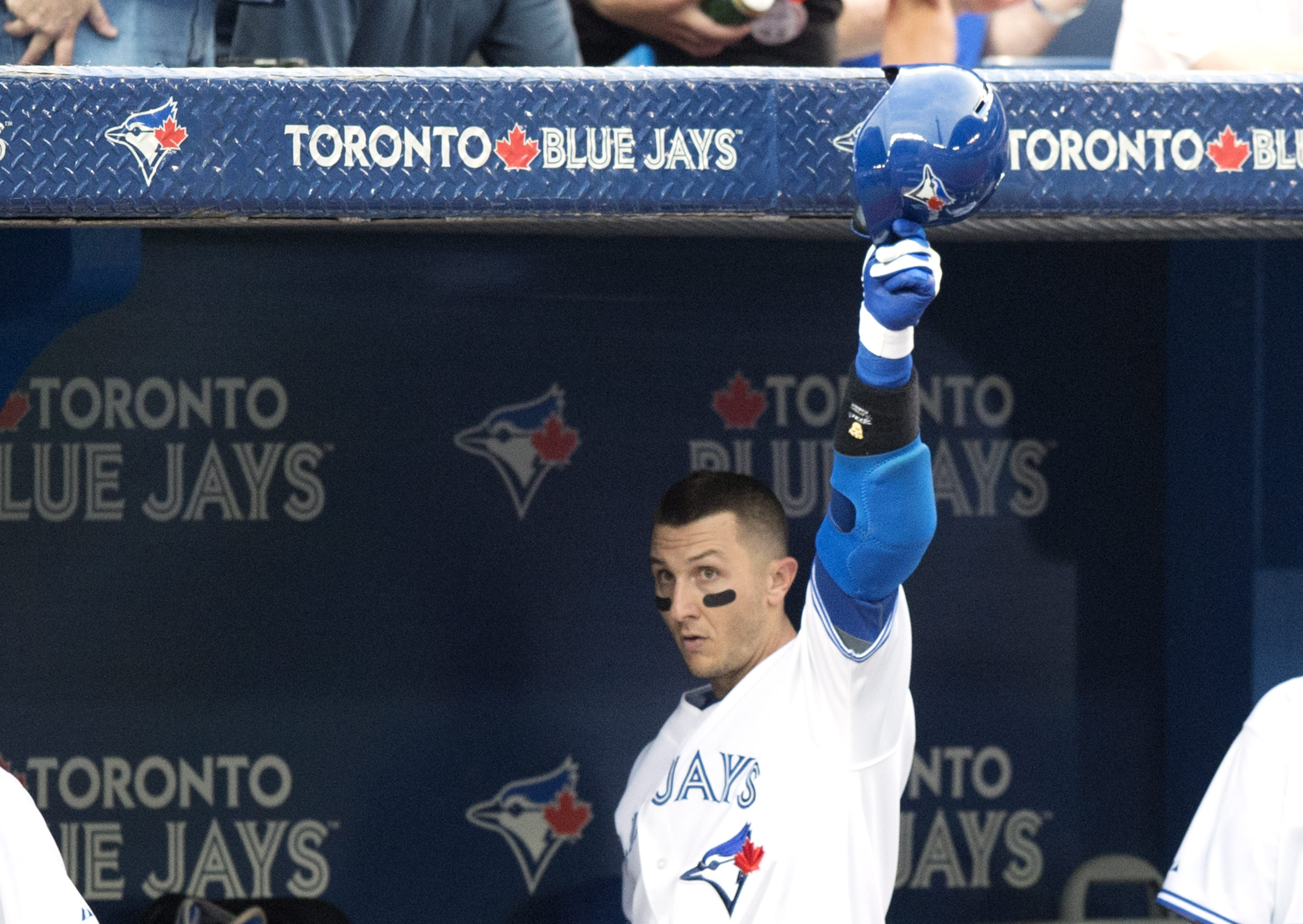 Toronto Blue Jays' Troy Tulowitzki tips his helmet after hitting a two-run home run during the third inning of a baseball game against the Philadelphia Phillies, Wednesday, July 29, 2015, in Toronto. (Darren Calabrese/The Canadian Press via AP) MANDATORY