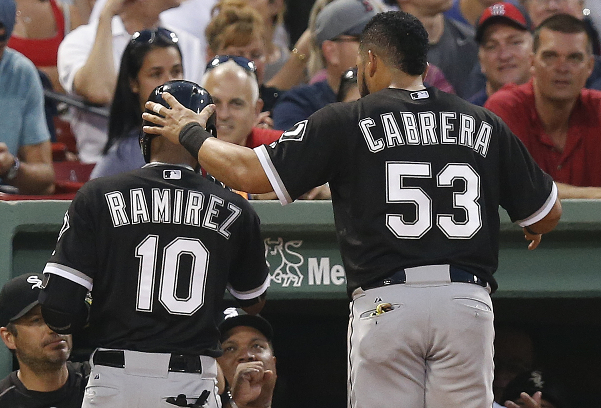 Chicago White Sox's Melky Cabrera (53) congratulates teammate Alexei Ramirez after Ramirez's solo home run during the third inning of a baseball game against the Boston Red Sox in Boston, Wednesday, July 29, 2015. (AP Photo/Michael Dwyer)