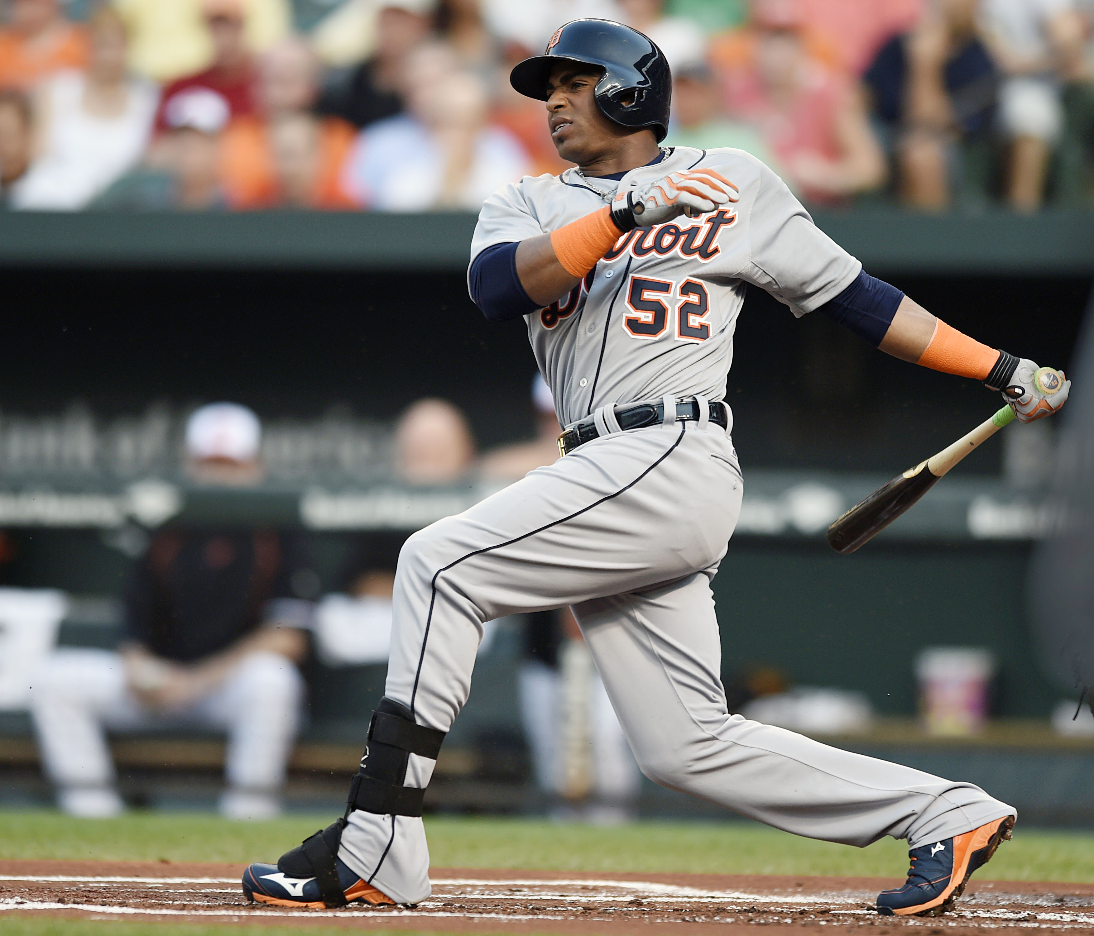 Detroit Tigers' Yoenis Cespedes follows through on a single against the Baltimore Orioles in the first inning of a baseball game, Thursday, July 30, 2015, in Baltimore.(AP Photo/Gail Burton)