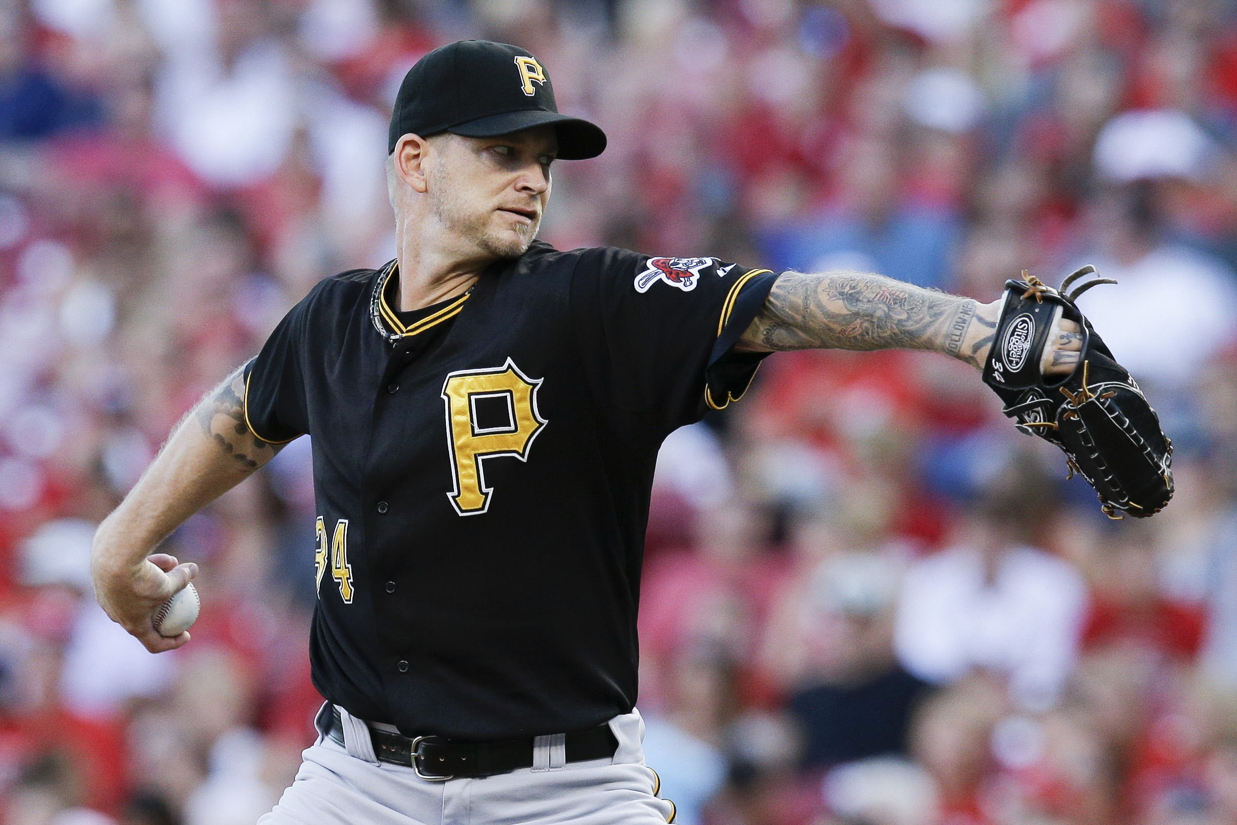Pittsburgh Pirates starting pitcher A.J. Burnett throws in the second inning of a baseball game against the Cincinnati Reds, Thursday, July 30, 2015, in Cincinnati. (AP Photo/John Minchillo)