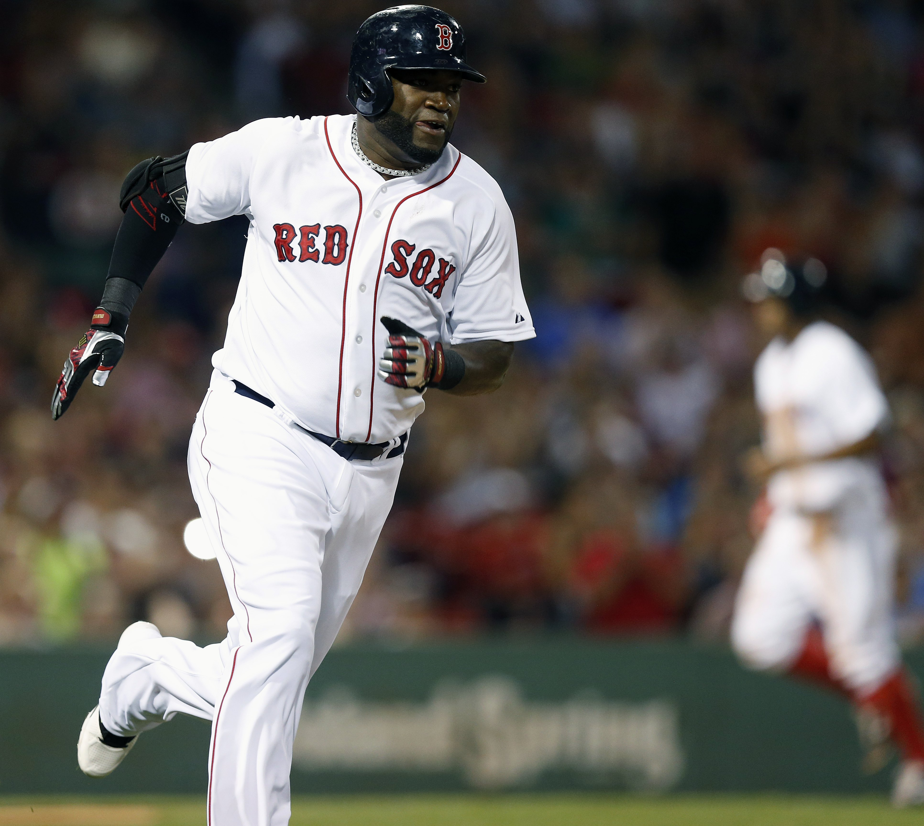 Boston Red Sox's David Ortiz runs out his RBI-double that scored Xander Bogaerts, right, during the first inning of a baseball game against the Chicago White Sox in Boston, Thursday, July 30, 2015. (AP Photo/Michael Dwyer)