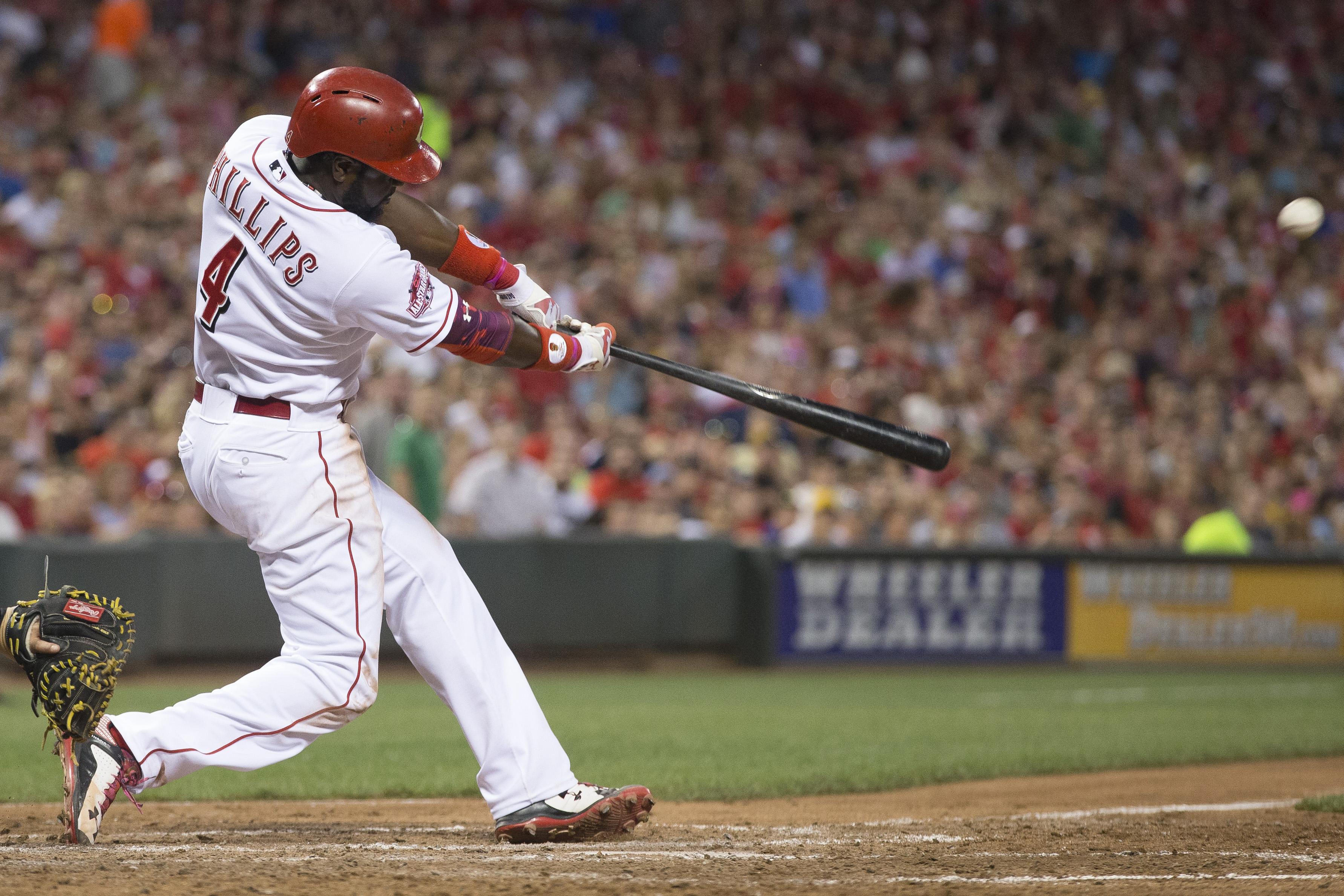 Cincinnati Reds' Brandon Phillips hits a three-run home run off Pittsburgh Pirates relief pitcher Deolis Guerra in the fifth inning of a baseball game, Thursday, July 30, 2015, in Cincinnati. (AP Photo/John Minchillo)