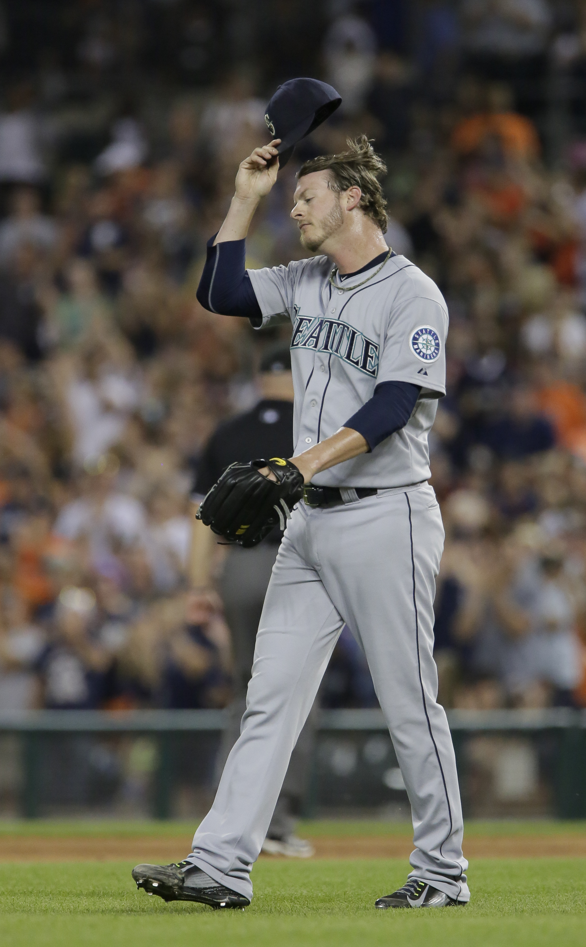 Seattle Mariners' Mark Lowe reacts after giving up a two-run home run to Detroit Tigers' Ian Kinsler during the eighth inning of a baseball game Monday, July 20, 2015 in Detroit. (AP Photo/Duane Burleson)