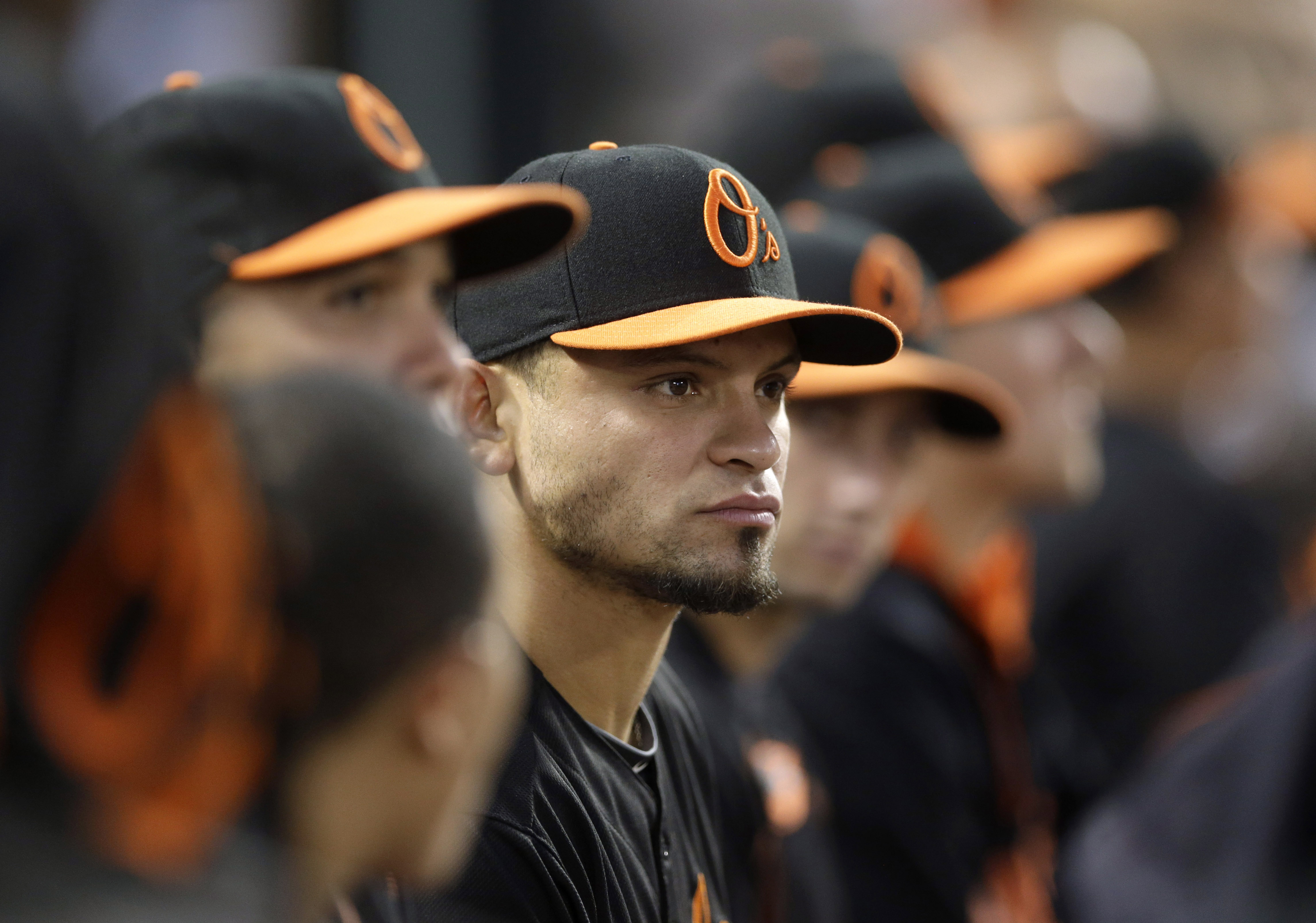 Baltimore Orioles' Gerardo Parra sits in the dugout in the fourth inning of a baseball game against the Detroit Tigers, Friday, July 31, 2015, in Baltimore. Parra was acquired Friday in a trade with the Milwaukee Brewers. (AP Photo/Patrick Semansky)