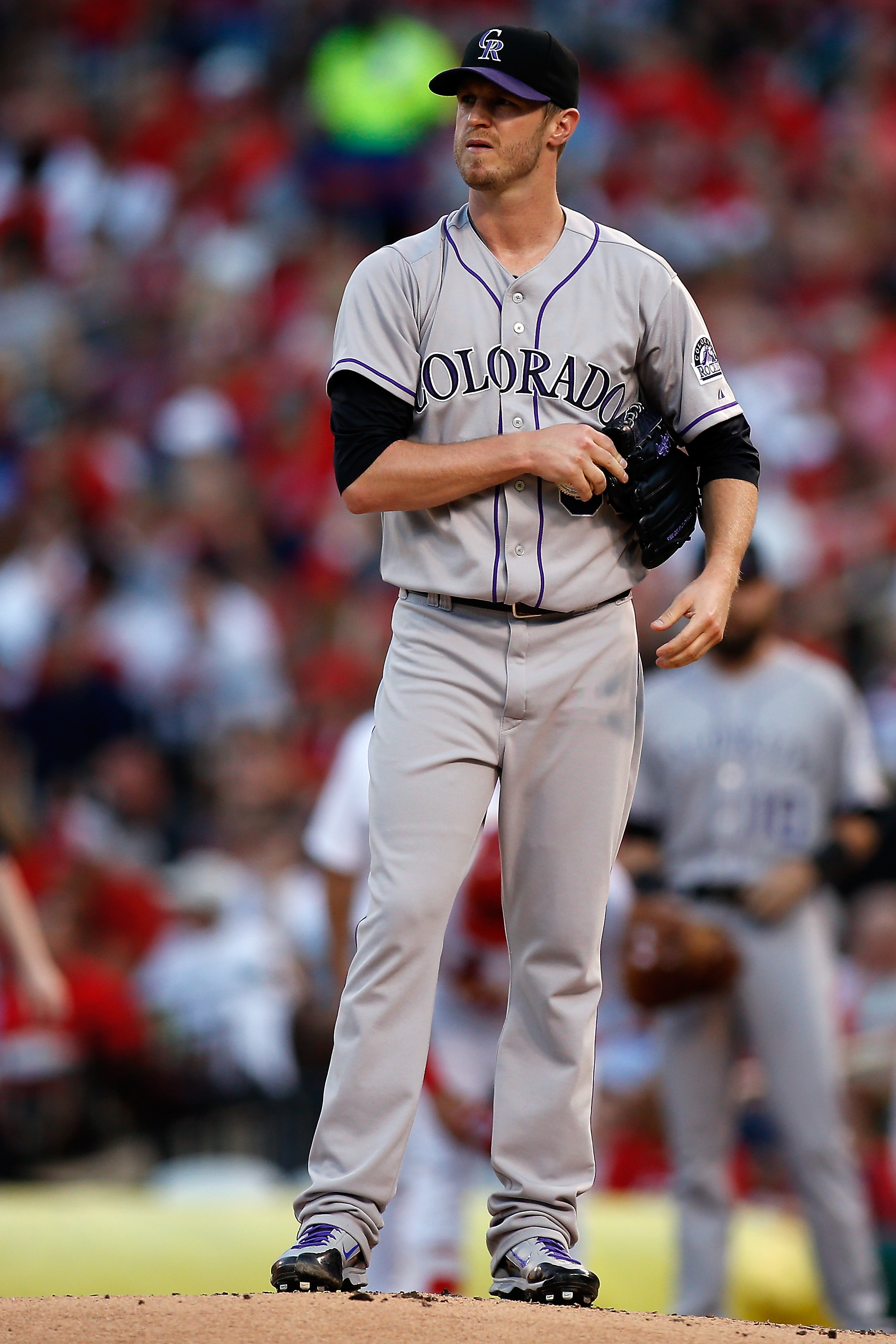 Colorado Rockies starting pitcher Kyle Kendrick  pauses on the mound after giving up a solo home run during the first inning of a baseball game against the St. Louis Cardinals, Friday, July 31, 2015, in St. Louis. (AP Photo/Scott Kane)