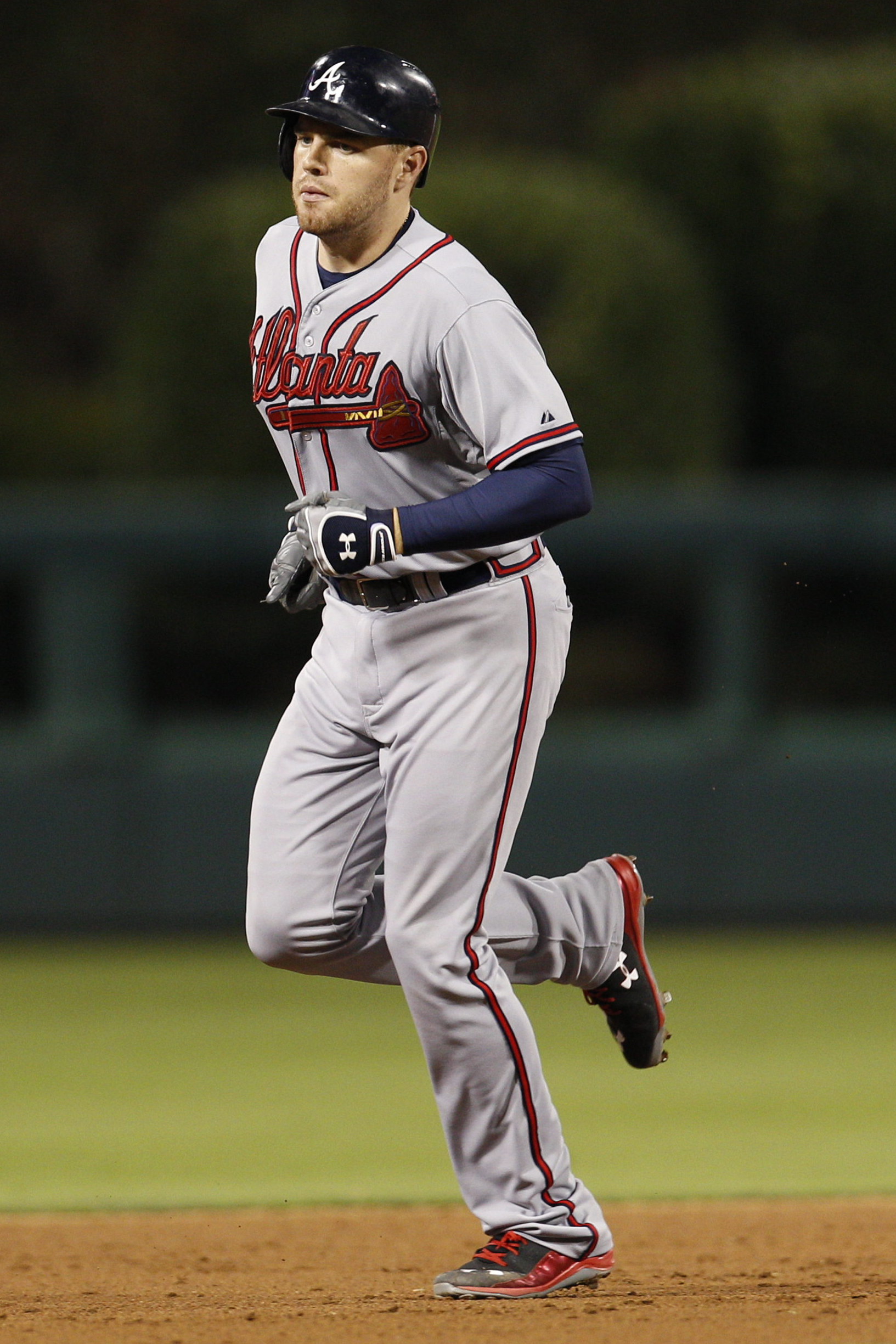 Atlanta Braves' Freddie Freeman rounds the bases after hitting a two run home run during the eighth inning of a baseball game against the Philadelphia Phillies, Friday, July 31, 2015, in Philadelphia. The Phillies won 9-3. (AP Photo/Chris Szagola)