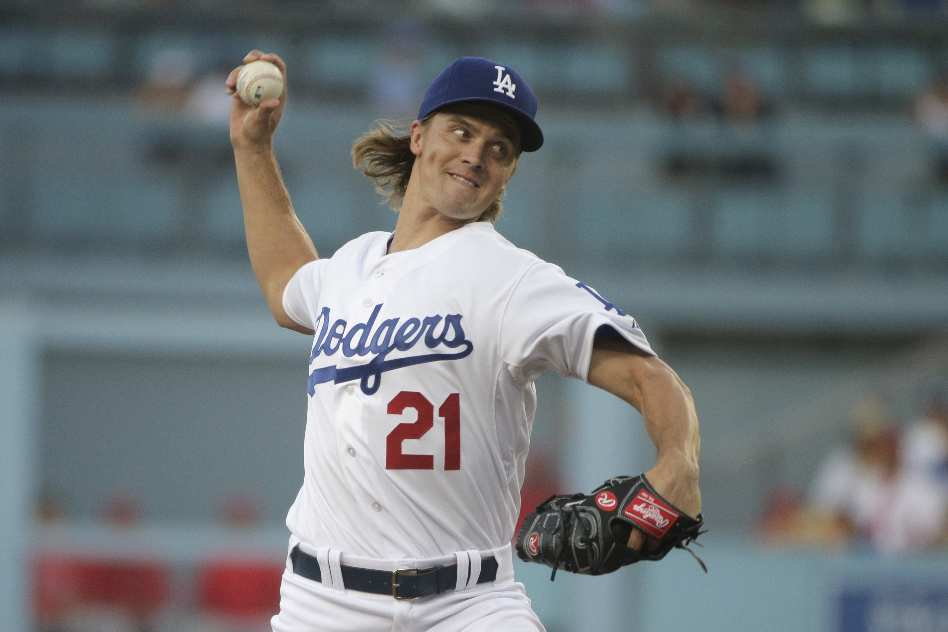 Los Angeles Dodgers starting pitcher Zack Greinke throws against the Los Angeles Angels during the first inning of a baseball game, Friday, July 31, 2015, in Los Angeles. (AP Photo/Jae C. Hong)