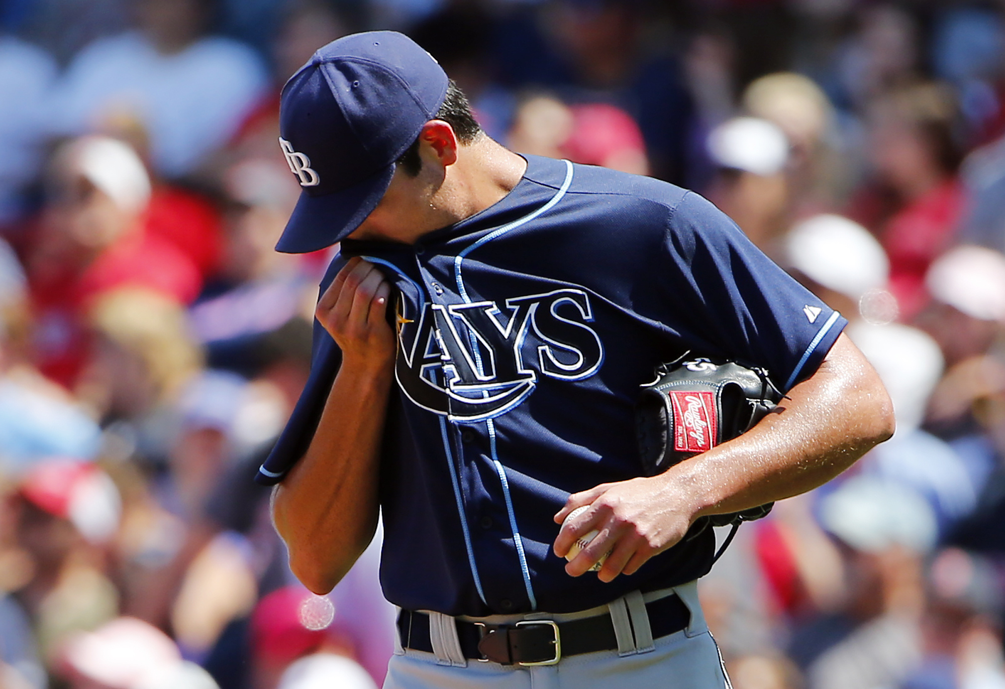 Tampa Bay Rays starting pitcher Matt Moore heads back to the mound after giving up a run to the Boston Red Sox during the third inning of a baseball game at Fenway Park in Boston, Saturday, Aug. 1, 2015. (AP Photo/Winslow Townson)