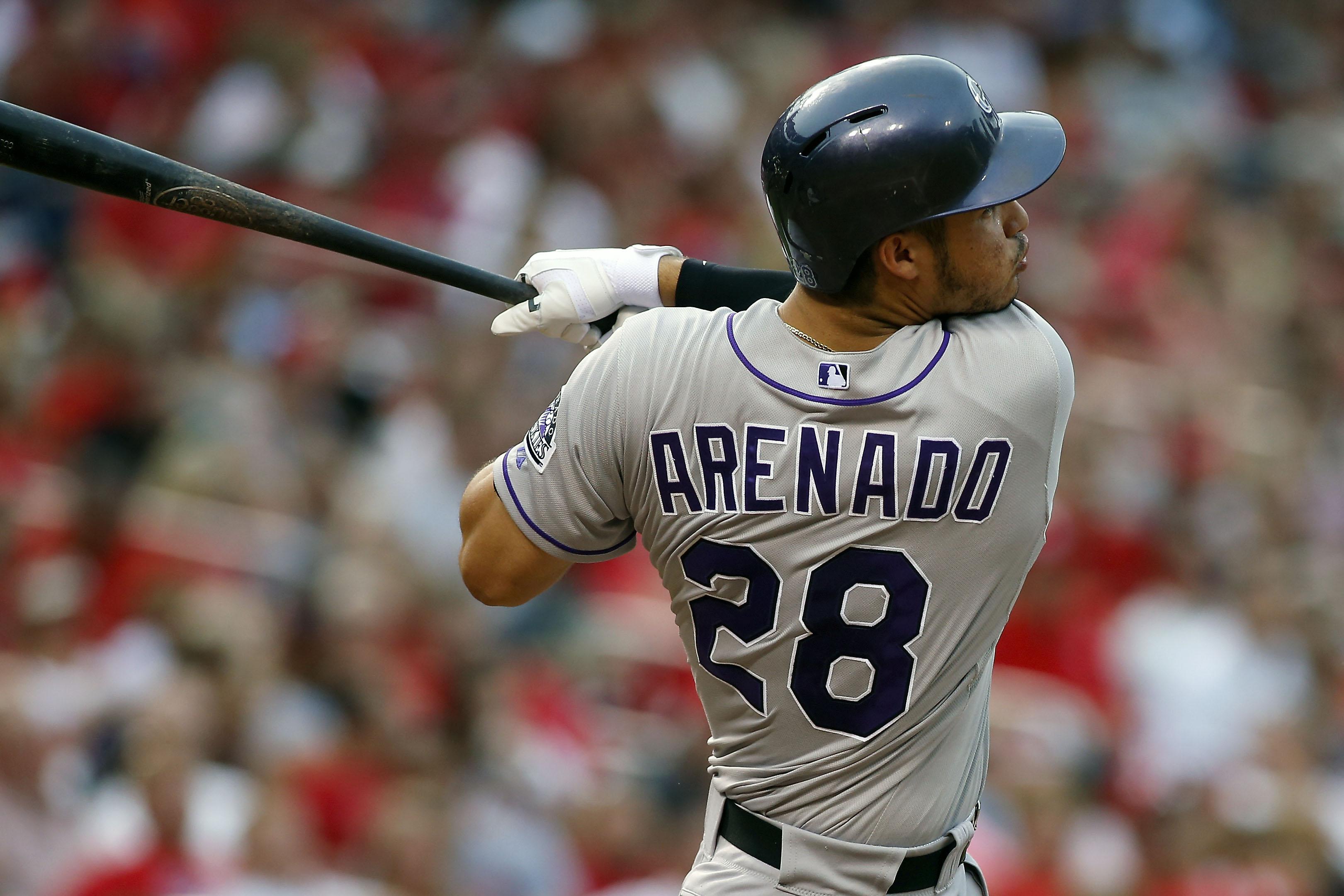 Colorado Rockies' Nolan Arenado follows through on a two run home run during the fourth inning of a baseball game against the St. Louis Cardinals Saturday, Aug. 1, 2015, in St. Louis. (AP Photo/Scott Kane)