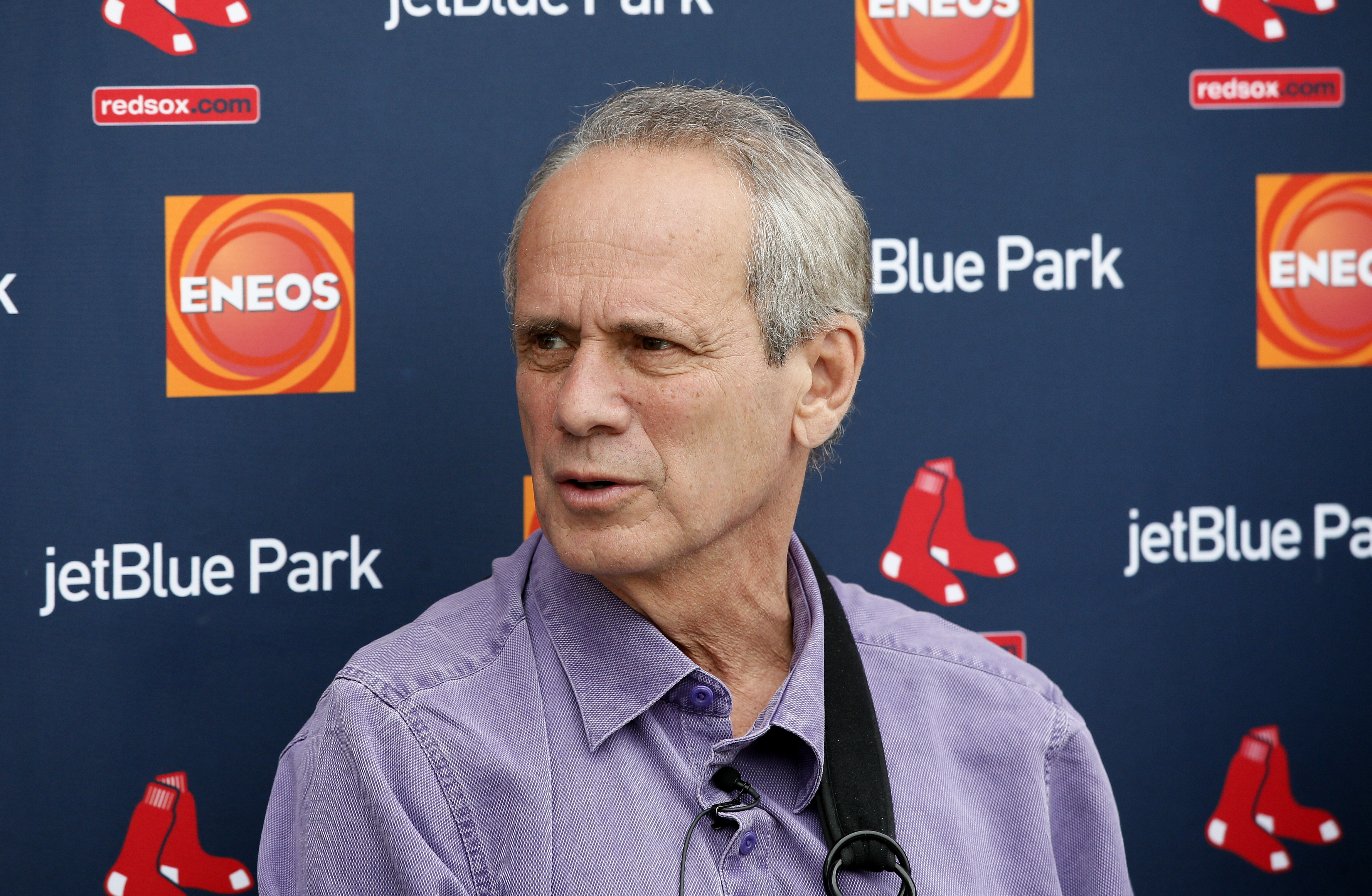 Boston Red Sox President and Chief Executive Officer Larry Lucchino, responds to questions during a news conference before a team workout at baseball spring training in Fort Myers Fla., Wednesday Feb. 25, 2015. (AP Photo/Tony Gutierrez)