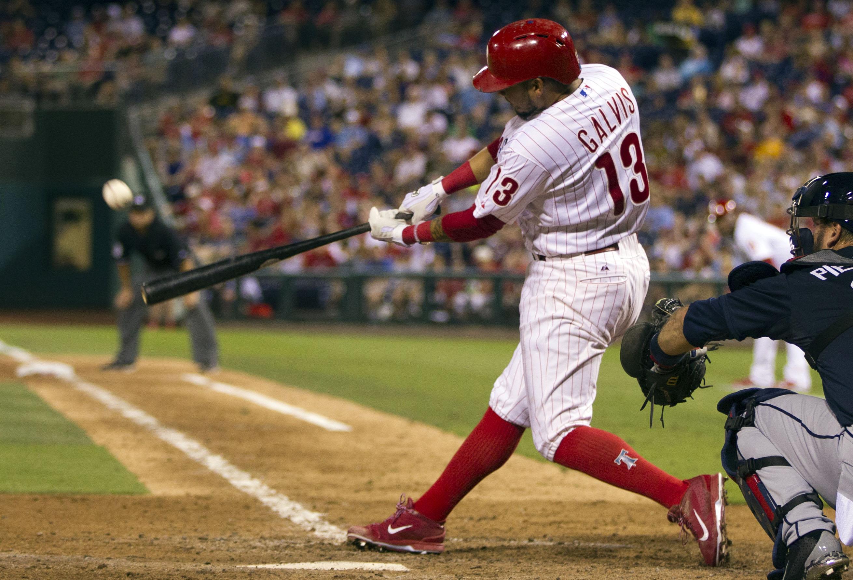 Philadelphia Phillies' Freddy Galvis hits a three-run home run during the sixth inning of a baseball game against the Atlanta Braves, Saturday, Aug. 1, 2015, in Philadelphia. (AP Photo/Chris Szagola)