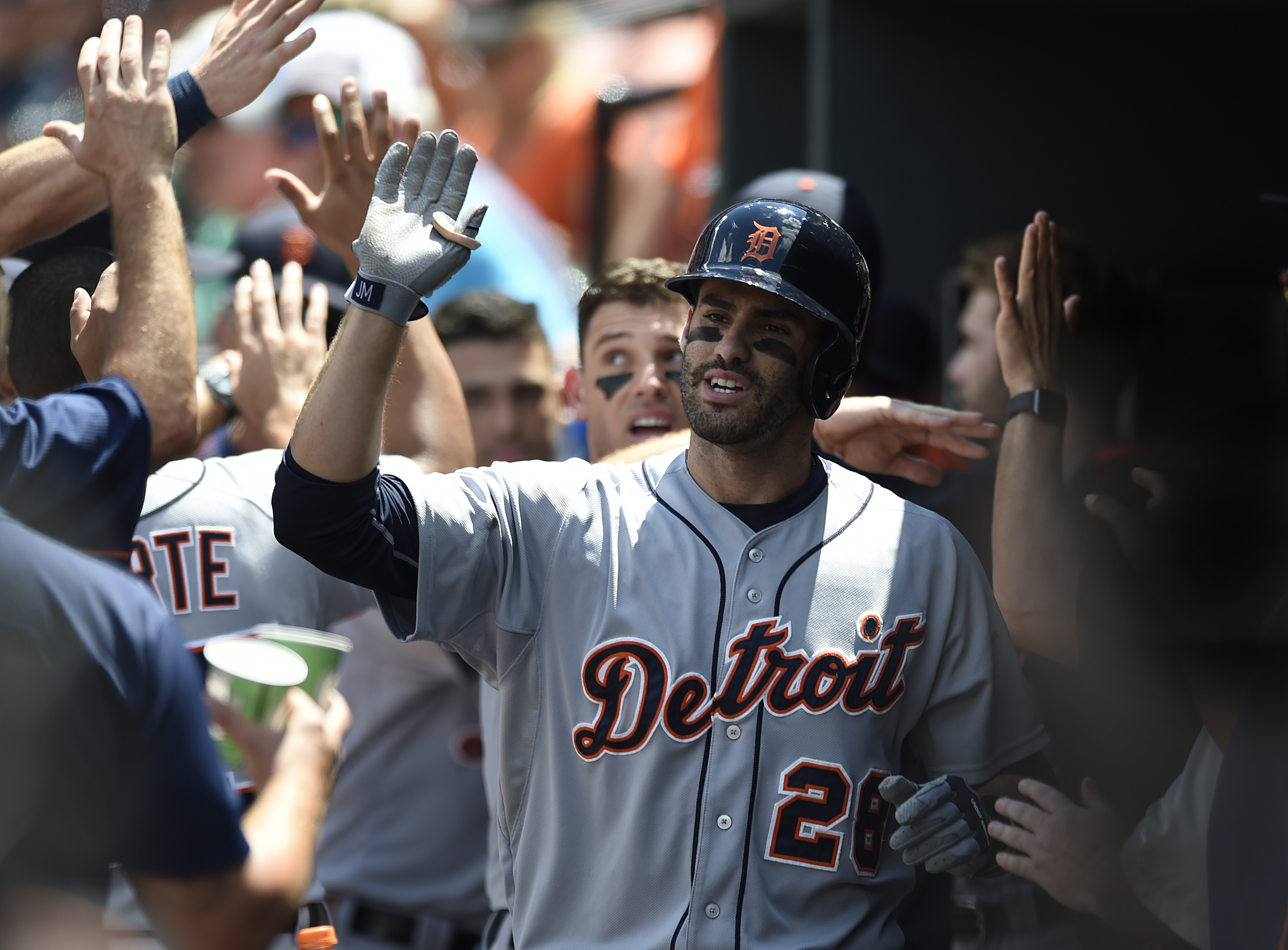 Detroit Tigers' J.D. Martinez is congratulated after hitting a three run home run against the Baltimore Orioles during the first inning of a baseball game, Sunday, Aug. 2, 2015, in Baltimore. (AP Photo/Gail Burton)