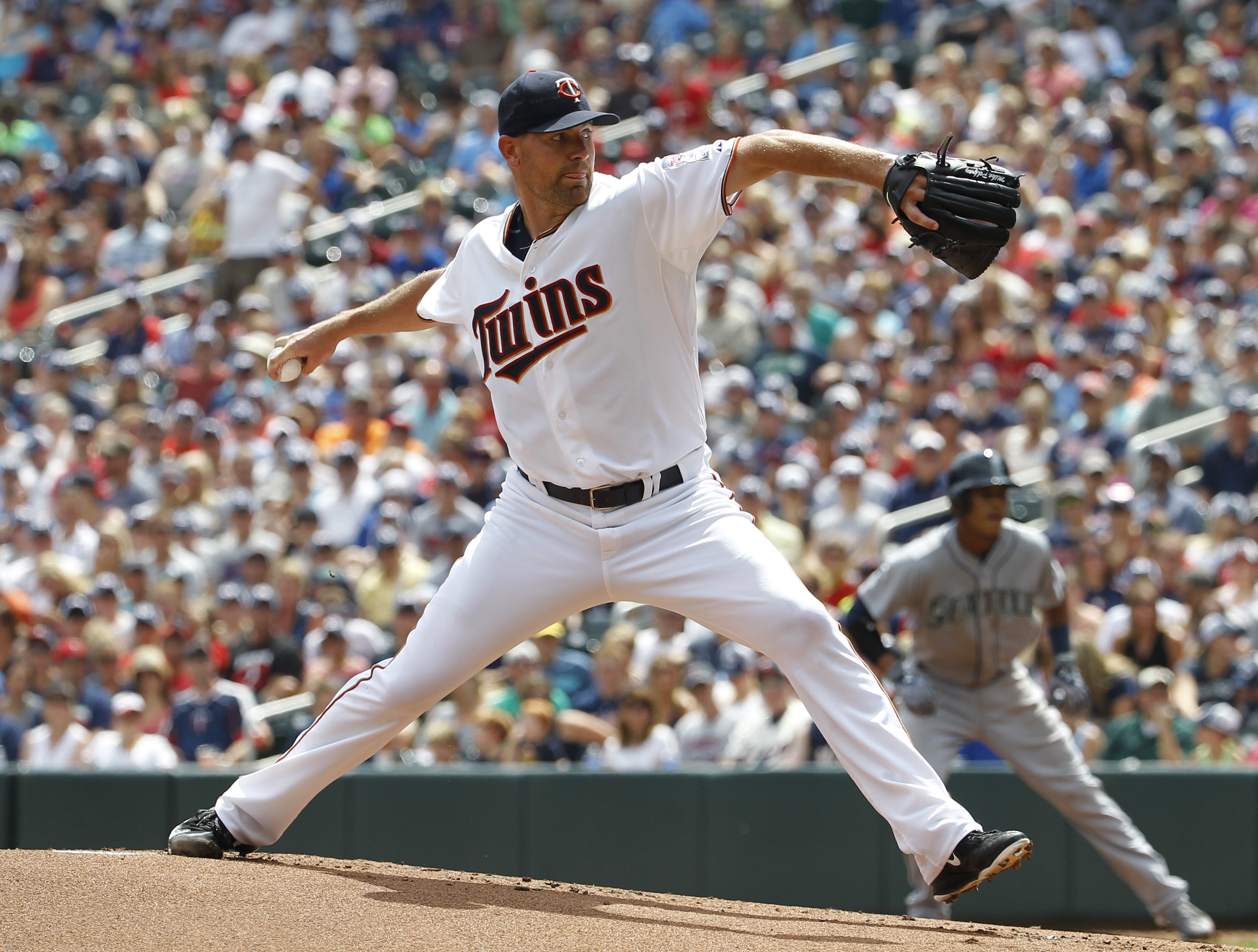 Minnesota Twins starting pitcher Mike Pelfrey delivers to the Seattle Mariners during the first inning of a baseball game in Minneapolis, Sunday, Aug. 2, 2015. (AP Photo/Ann Heisenfelt)