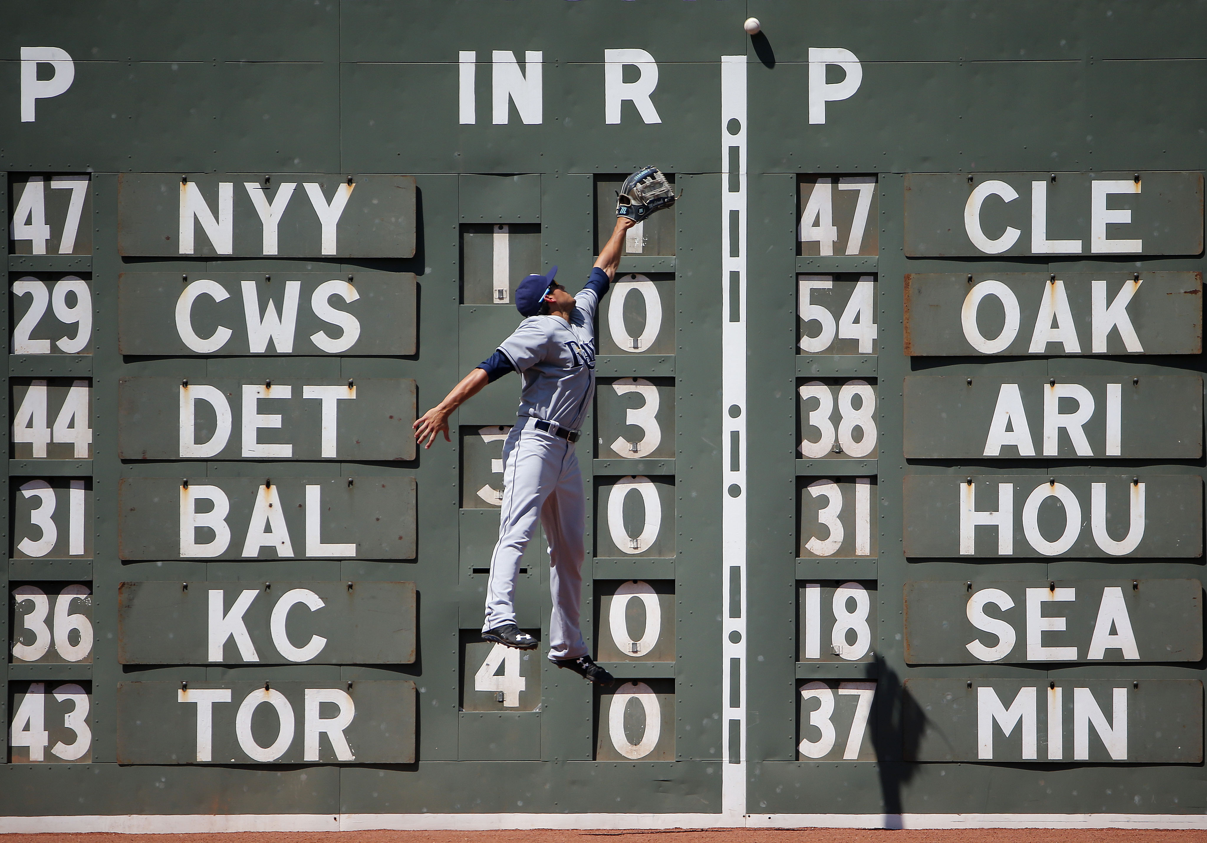 Tampa Bay Rays left fielder Mikie Mahtook leaps but can't get to an RBI double by Boston Red Sox's David Ortiz during the third inning of a baseball game at Fenway Park in Boston Sunday, Aug. 2, 2015. (AP Photo/Winslow Townson)