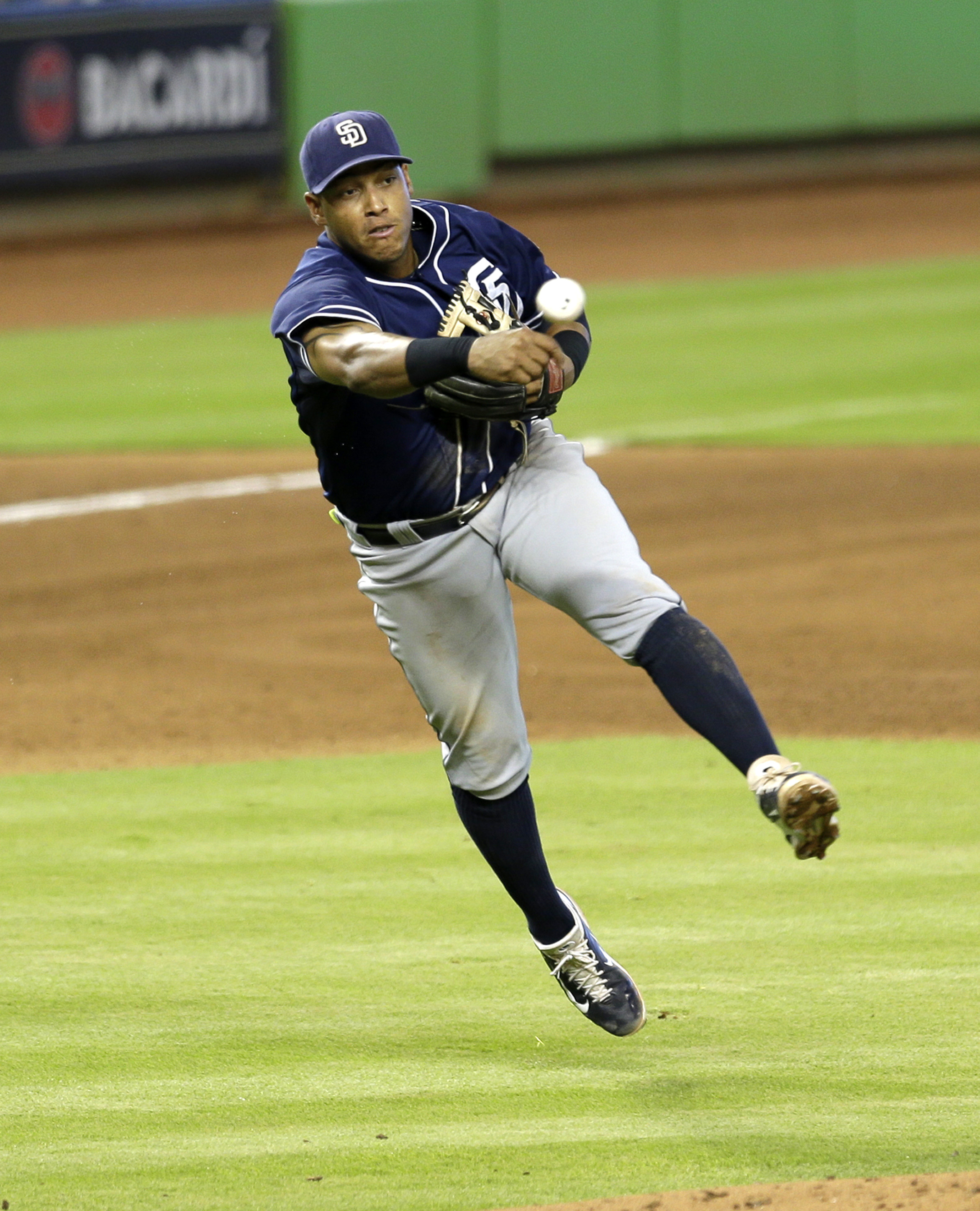 San Diego Padres third baseman Yangervis Solarte throws out Miami Marlins' Miguel Rojas at first base after fielding a ground ball in the fifth inning of a baseball game, Sunday, Aug. 2, 2015, in Miami. (AP Photo/Alan Diaz)
