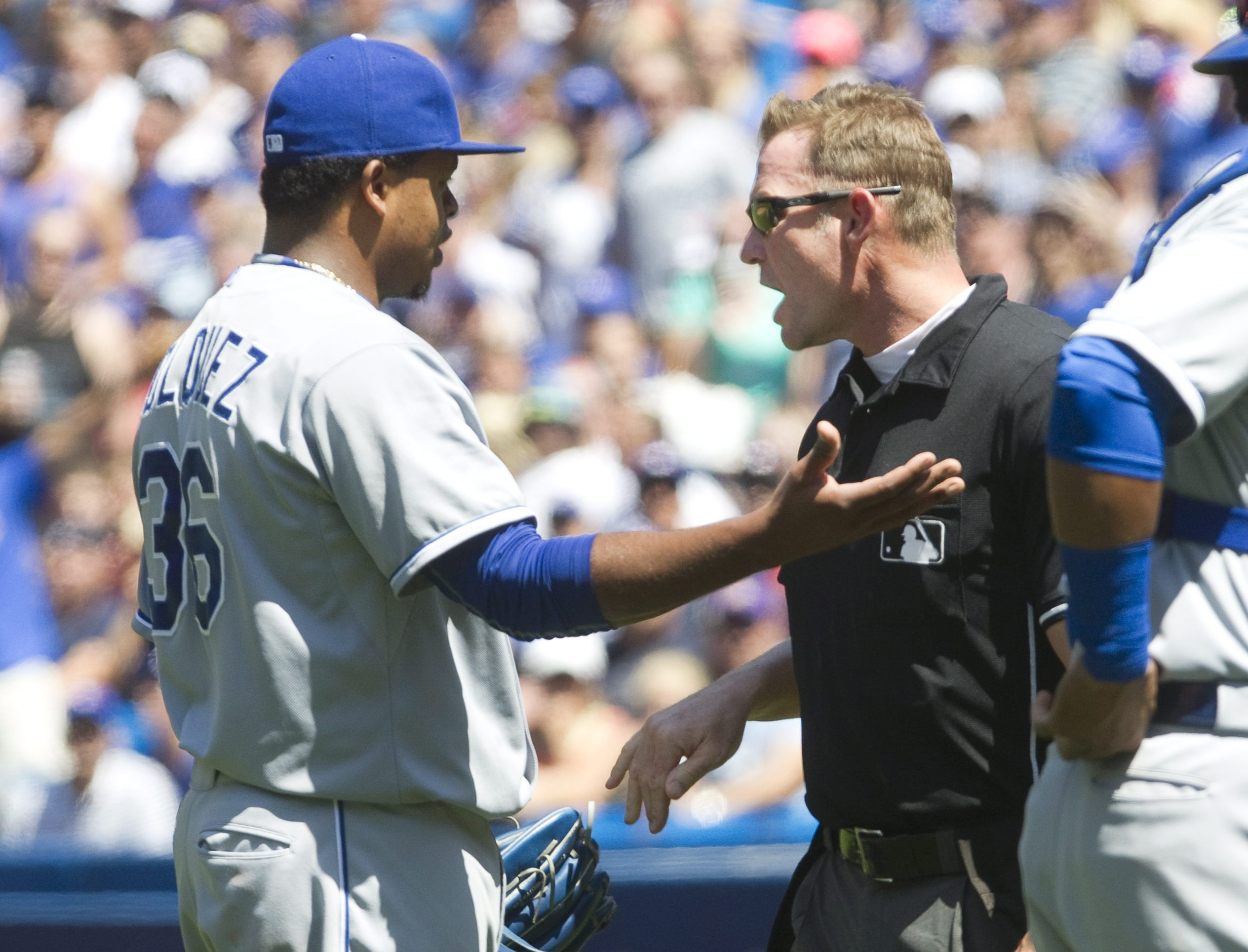 Kansas City Royals starting pitcher Edinson Volquez is given a warning by home plate umpire Jim Wolf after brushing Toronto Blue Jays' Josh Donaldson back with a pitch during the third inning of a baseball game against the Kansas City Royals in Toronto, S