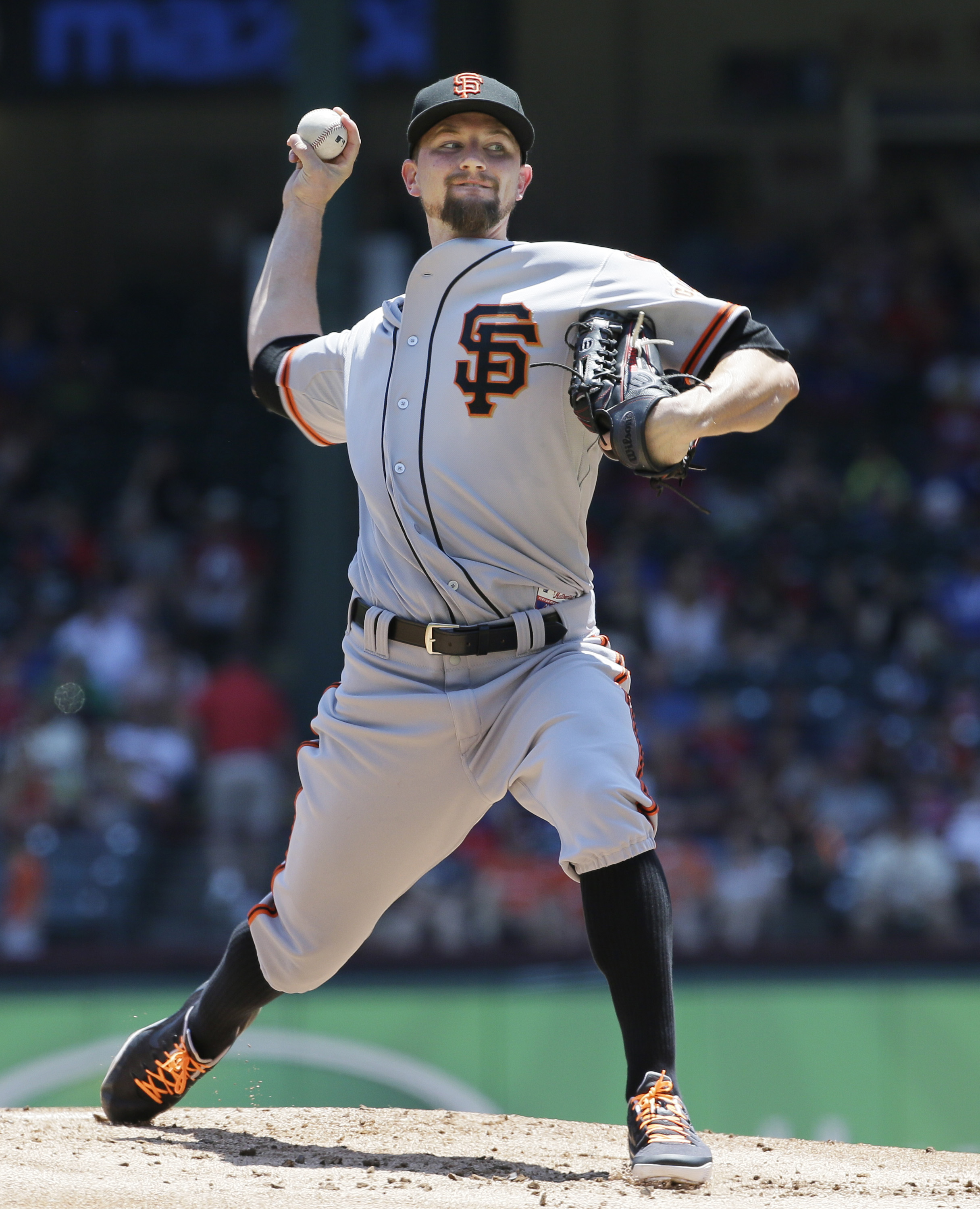 San Francisco Giants starting pitcher Mike Leake throws during the first inning of a baseball game against the Texas Rangers in Arlington, Texas, Sunday, Aug. 2, 2015. (AP Photo/LM Otero)