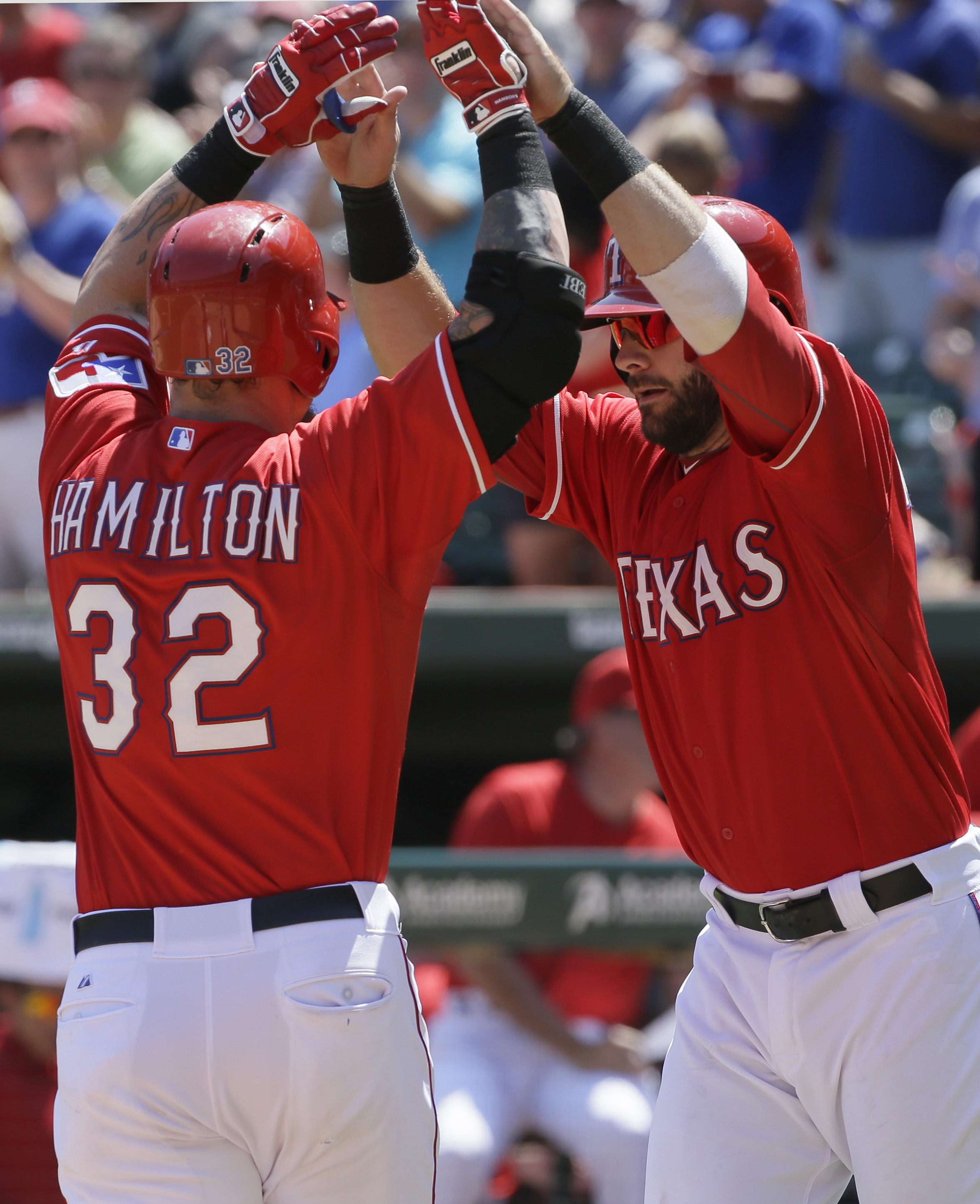 Texas Rangers' Josh Hamilton (32) is met at home plate by teammate Mitch Moreland after hitting a two-run home run, scoring both players, during the seventh inning of a baseball game against the San Francisco Giants in Arlington, Texas, Sunday, Aug. 2, 20