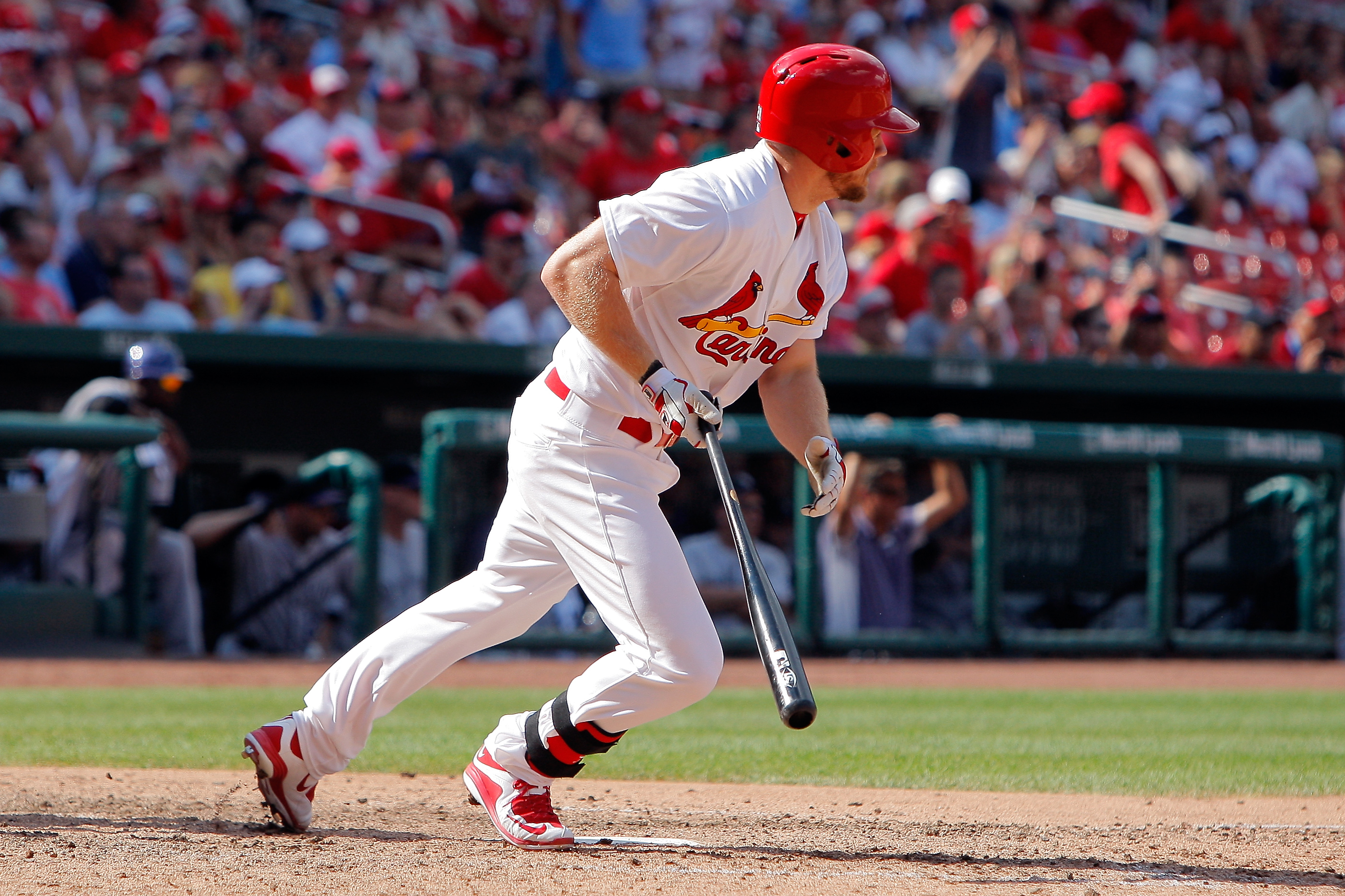 St. Louis Cardinals' Brandon Moss hits a walkoff single to drive in Jason Heyward to score the winning run during the ninth inning of a baseball game against the Colorado Rockies, Sunday, Aug. 2, 2015, in St. Louis. (AP Photo/Scott Kane)