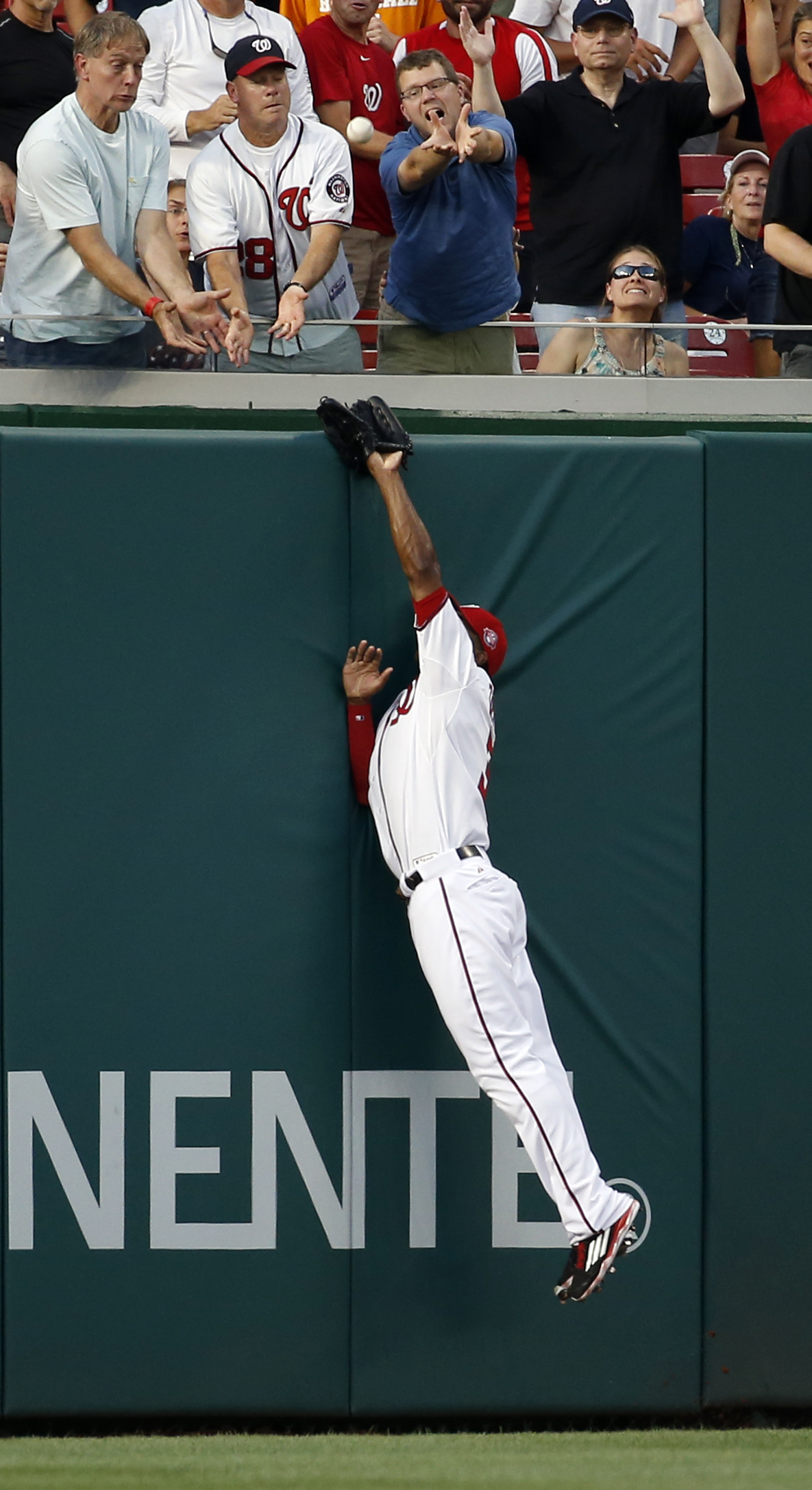 Washington Nationals center fielder Michael Taylor (3) can't catch a two-run homer by Arizona Diamondbacks' David Peralta (6) during the fourth inning of a baseball game at Nationals Park, Monday, Aug. 3, 2015, in Washington. (AP Photo/Alex Brandon)