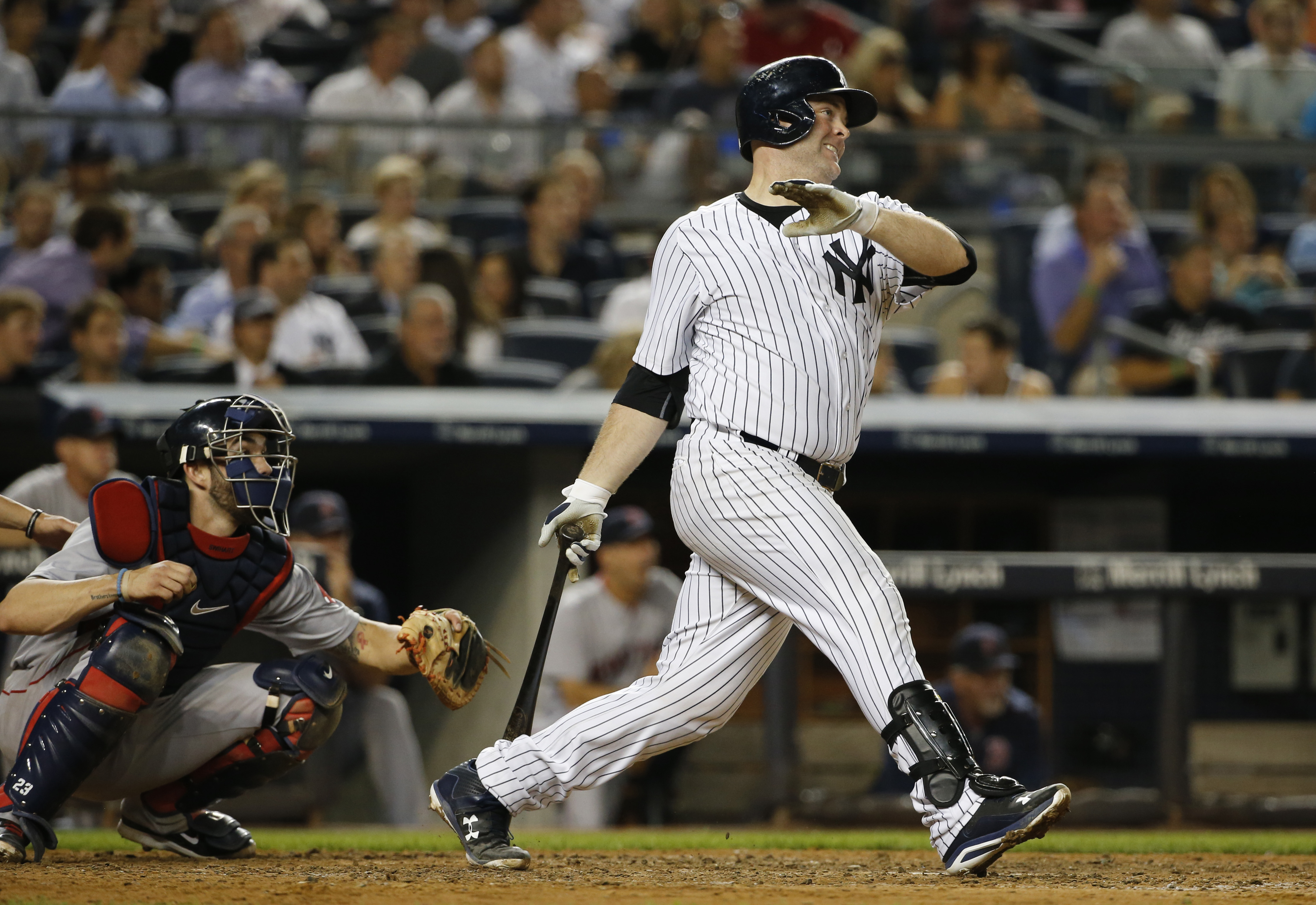 New York Yankees Brian McCann watches a sixth-inning RBI double in a baseball game against the Boston Red Sox at Yankee Stadium in New York, Tuesday, Aug. 4, 2015.  (AP Photo/Kathy Willens)