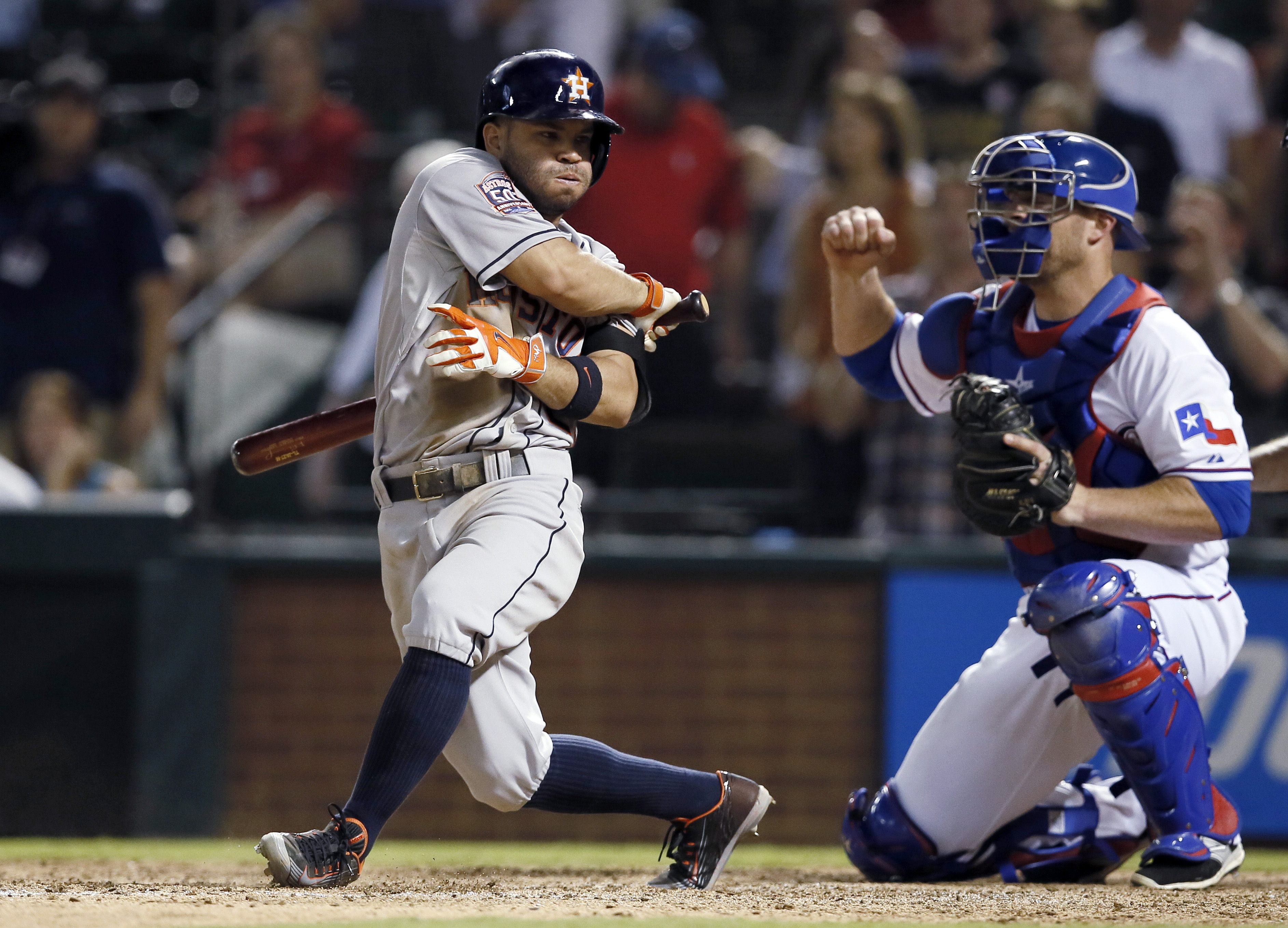 Texas Rangers catcher Chris Gimenez pumps his fist as Houston Astros' Jose Altuve swings at a pitch for a third strike, ending the 4-3 Rangers win in a baseball game Tuesday, Aug. 4, 2015, in Arlington, Texas. (AP Photo/Tony Gutierrez)