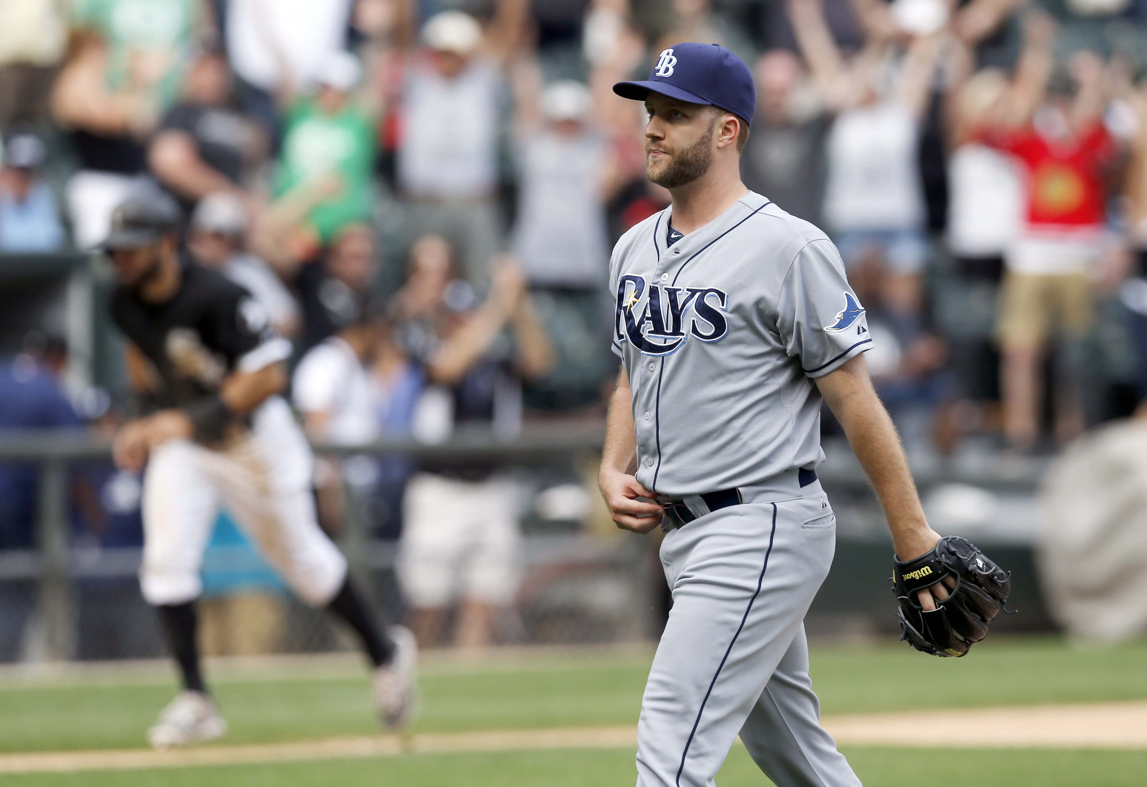 Tampa Bay Rays relief pitcher Brad Boxberger walks to the dugout after giving up a bases loaded walk to Chicago White Sox's Avisail Garcia, scoring Adam Eaton, left, giving the White Sox a 6-5 win in the 10th inning of a baseball game, Wednesday, Aug. 5,