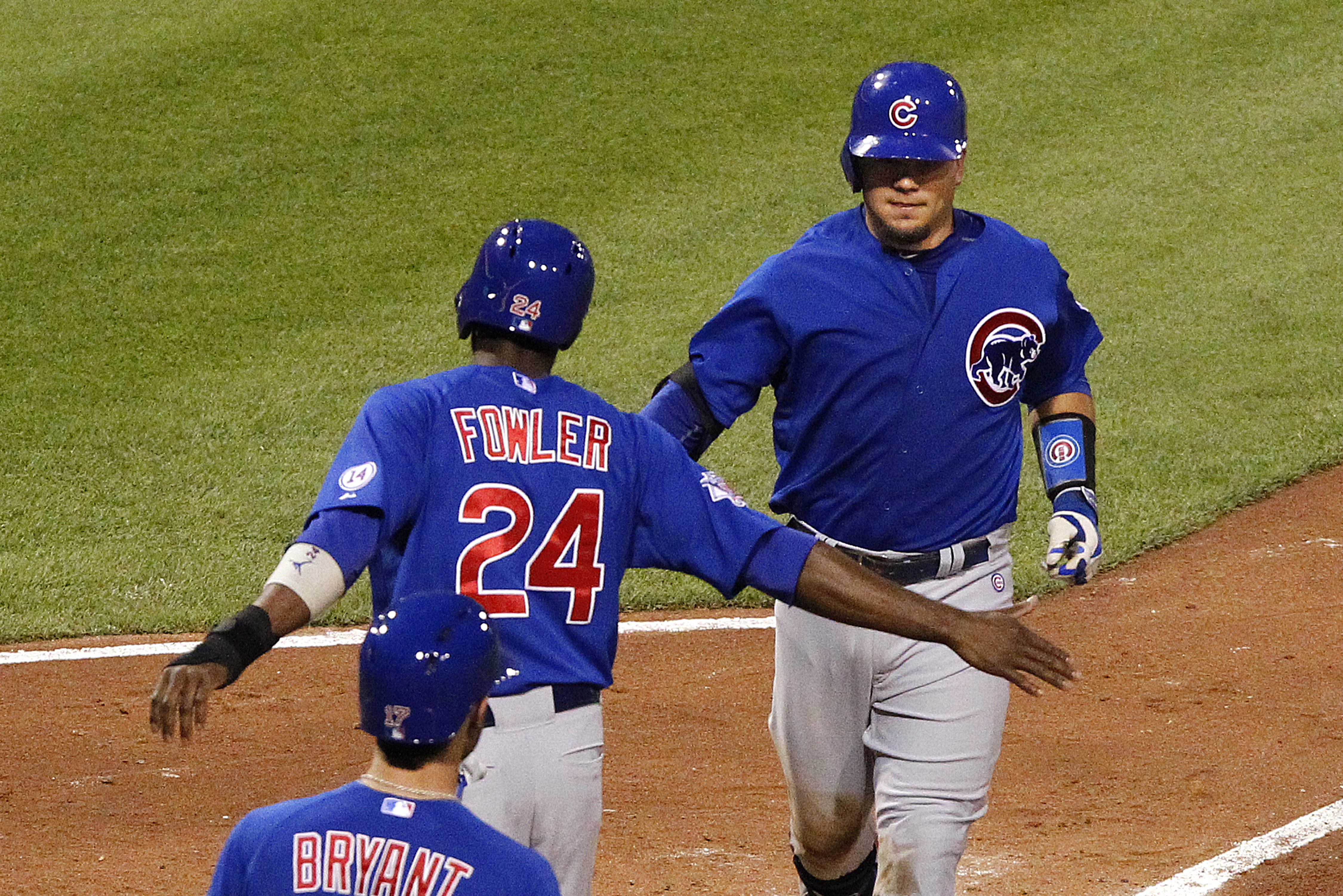Chicago Cubs' Kyle Schwarber, right, is greeted by teammate Dexter Fowler (24)  after hitting a two-run home run off Pittsburgh Pirates starting pitcher Jeff Locke in the sixth inning of a baseball game against the Pittsburgh Pirates, Wednesday, Aug. 5, 2