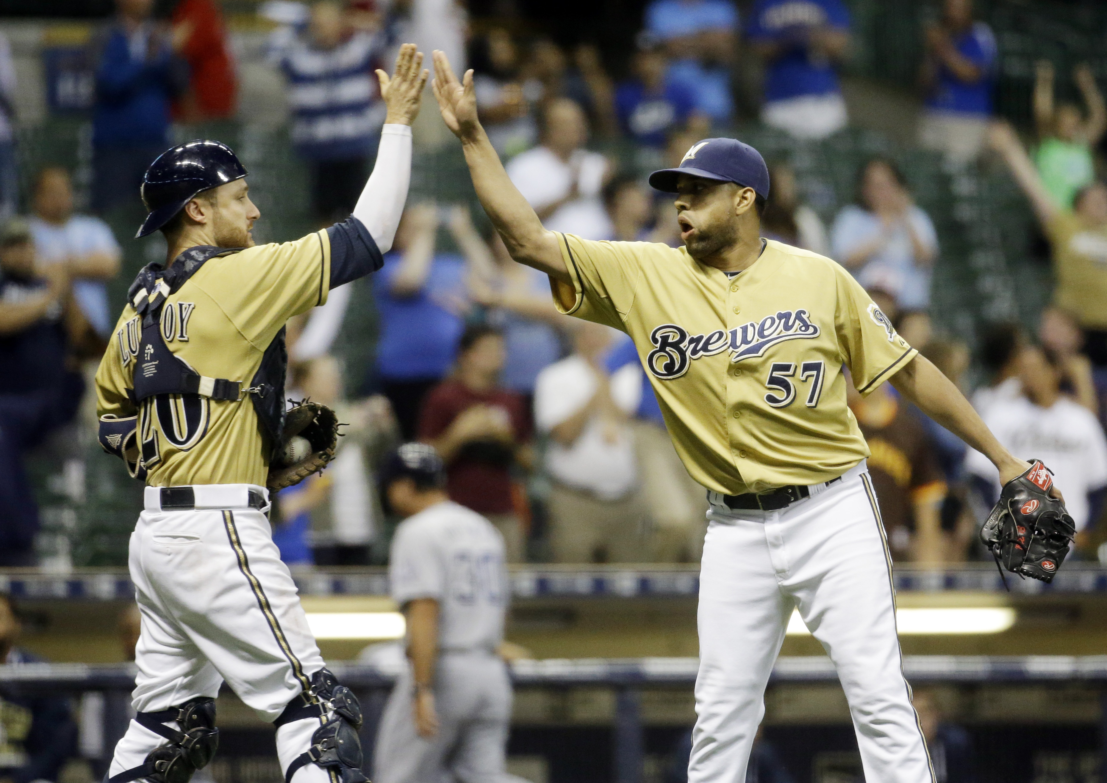 Milwaukee Brewers catcher Jonathan Lucroy and relief pitcher Francisco Rodriguez celebrate after  a baseball game against the San Diego Padres Wednesday, Aug. 5, 2015, in Milwaukee. The Brewers won 8-5. (AP Photo/Morry Gash)