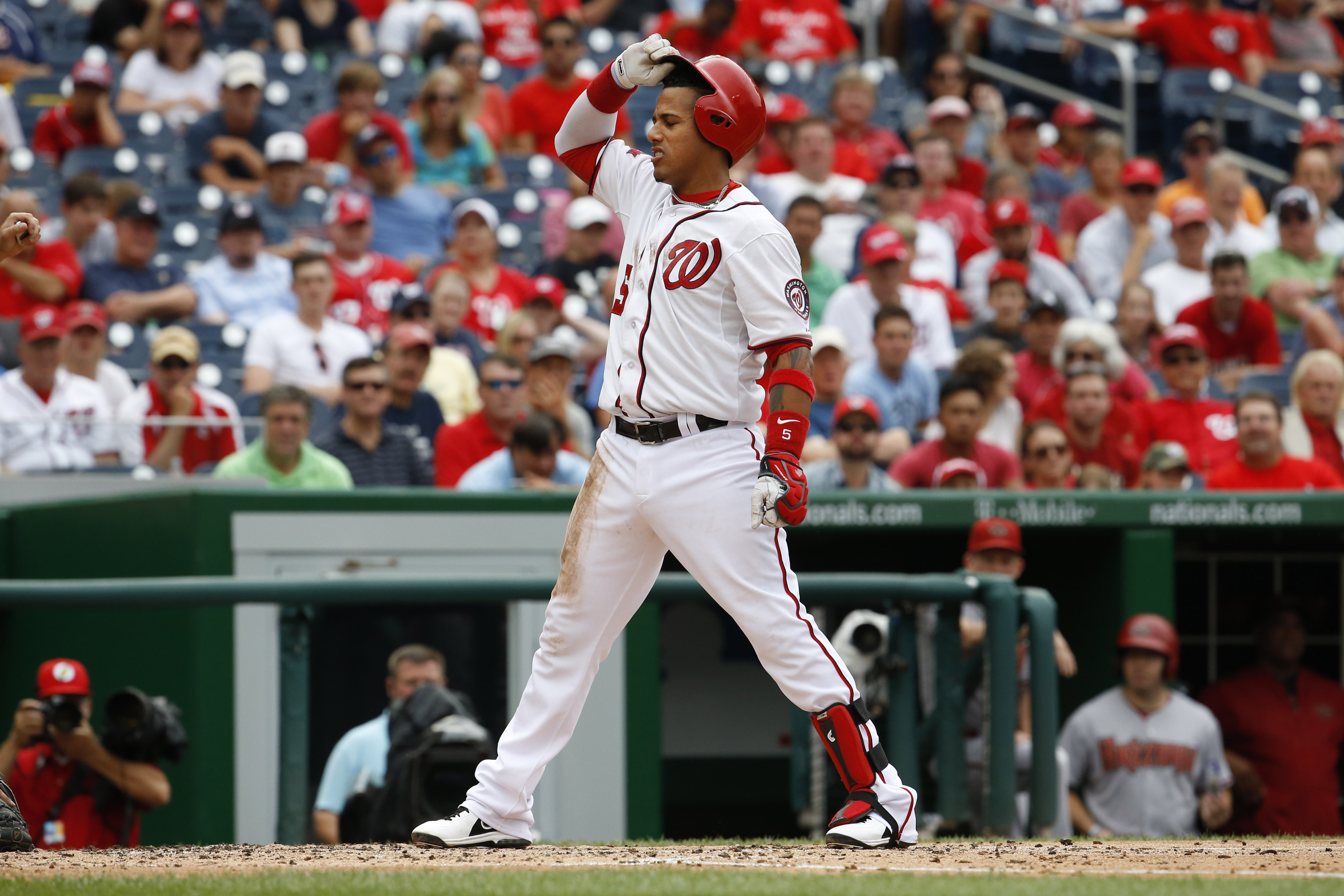 Washington Nationals' Yunel Escobar (5) reacts after his hand was hit by a pitch from the Arizona Diamondbacks in the third inning of a baseball game in Washington, Thursday, Aug. 6, 2015. (AP Photo/Jacquelyn Martin)